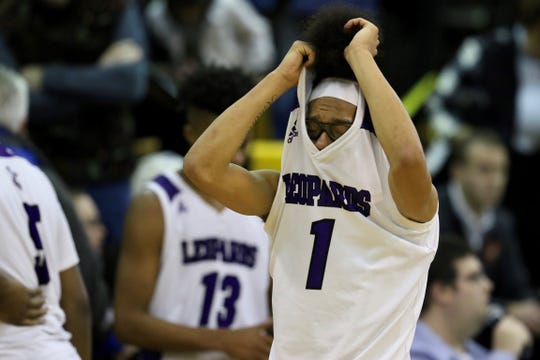 Greece Odyssey's Travon Harper reacts to Saturday's 61-47 loss to Olean in the state Class B quarterfinals at Greece Athena.