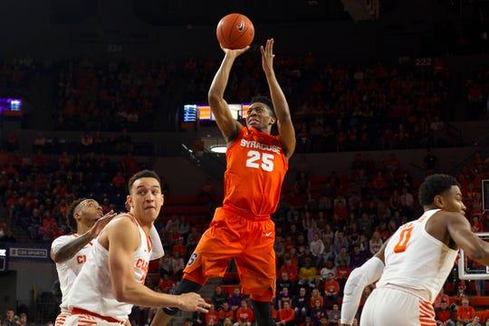 Syracuse  guard Tyus Battle (25) shoots over the Clemson defense on Saturday.