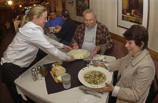 Nov. 5, 2007: Martha Farabel serves up a lunch of greens and beans and fettucine alfredo to Linda and Joe LaTempa at the popular Dentico's Italian Villa in Rochester.