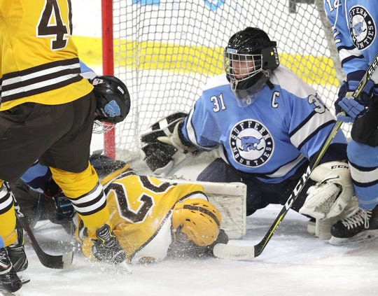 Suffern goalie Mike Harper fights a crowded crease but Canton's John Mahoney got the goal in the first period.