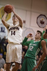 Pittsford Mendon's Dan Cook elevates for two of his 32 points as Lewiston-Porter's Zachary Clayborne looks on during Mendon's 87-55 win in the state Class A quarterfinals at Greece Athena.