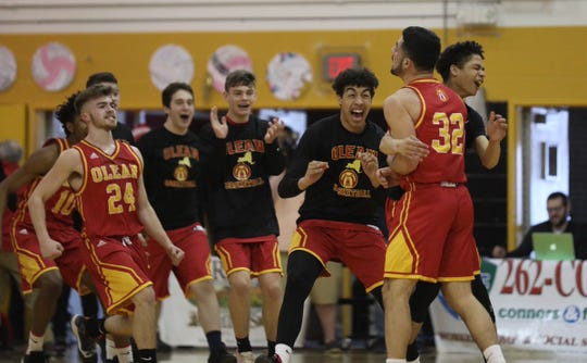 Olean players celebrate a buzzer-beater at the end of the first half of Saturday's 61-47 win over Greece Odyssey in the state Class B quarterfinals at Greece Athena.
