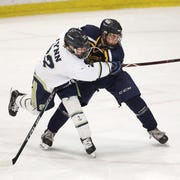 Webster Thomas's Liam Mayer pressures Skaneatales's Luke Lynn in the Division 2 semifinal game .