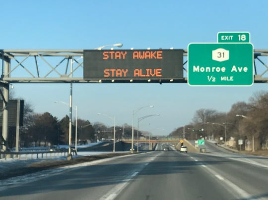 A sign over Interstate 490 urges motorists to stay awake during the daylight saving time weekend switch in 2019.