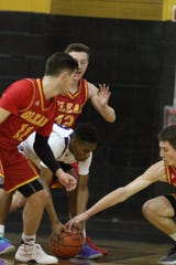 Trapped between Olean's Mike Schmidt and Brian Ramarge, Greece Odyssey 's Ray Colbert loses the ball and tries to grab it.