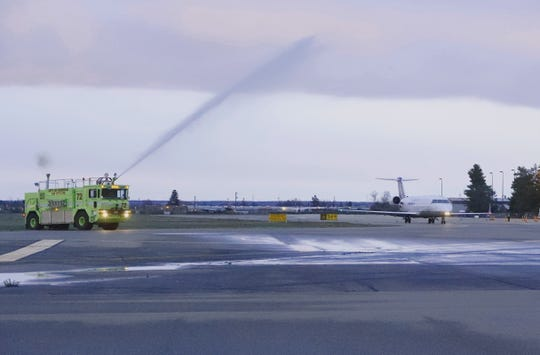 United's inaugural flight from Redding to Los Angeles departs about 6:40 a.m. Saturday, March 9, 2019, while receiving a water salute from the Redding Fire Department.
