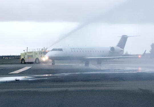 One of two Redding fire engines gives a water salute to the inaugural United Express flight from Redding to Los Angeles about 6:40 a.m. Saturday, March 9, 2019, at the Redding Municipal Airport.
