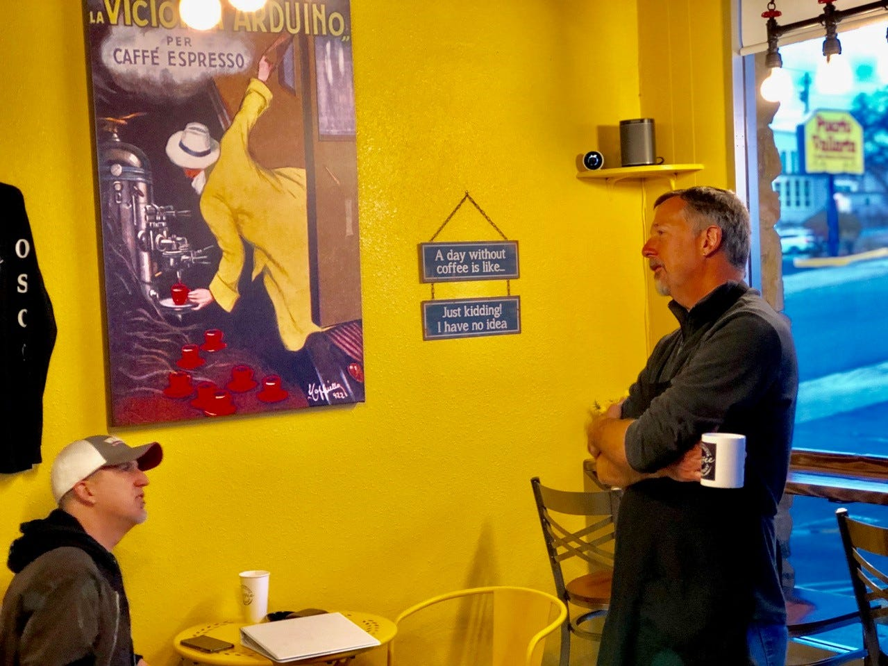 Co-owner Eric Fogelin chats with an early morning customer at Old Shasta Coffee Company in west Redding.