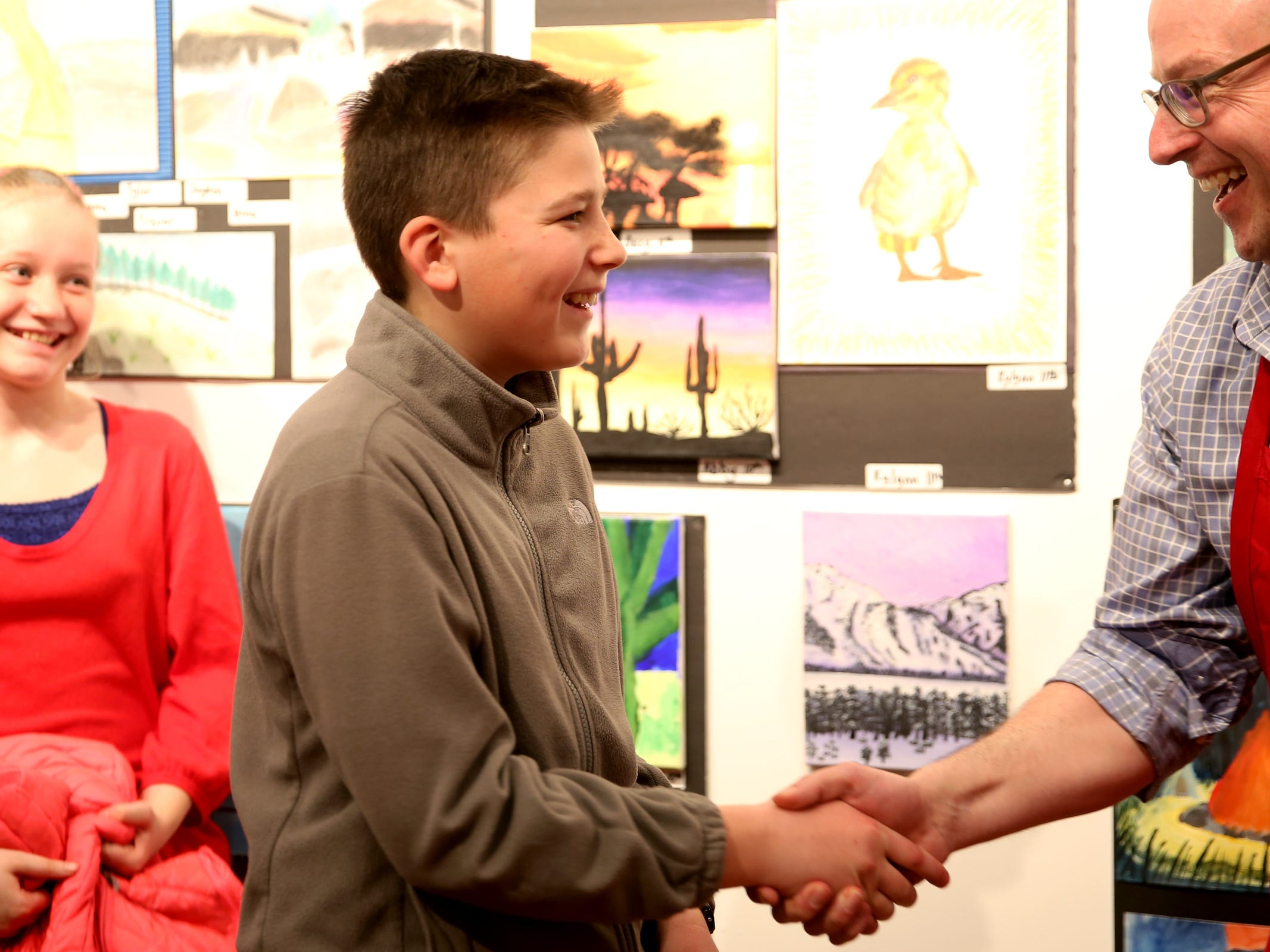 Nikita Matvechuk, from Mid-Valley Christian Academy, accepts the second-place award for middle schoolers during the 10th annual Young Artists' Showcase at the Bush Barn Art Center in Salem on March 9, 2019. The exhibit features artwork by more than 400 students in Marion, Polk and Yamhill counties and runs through April 20.