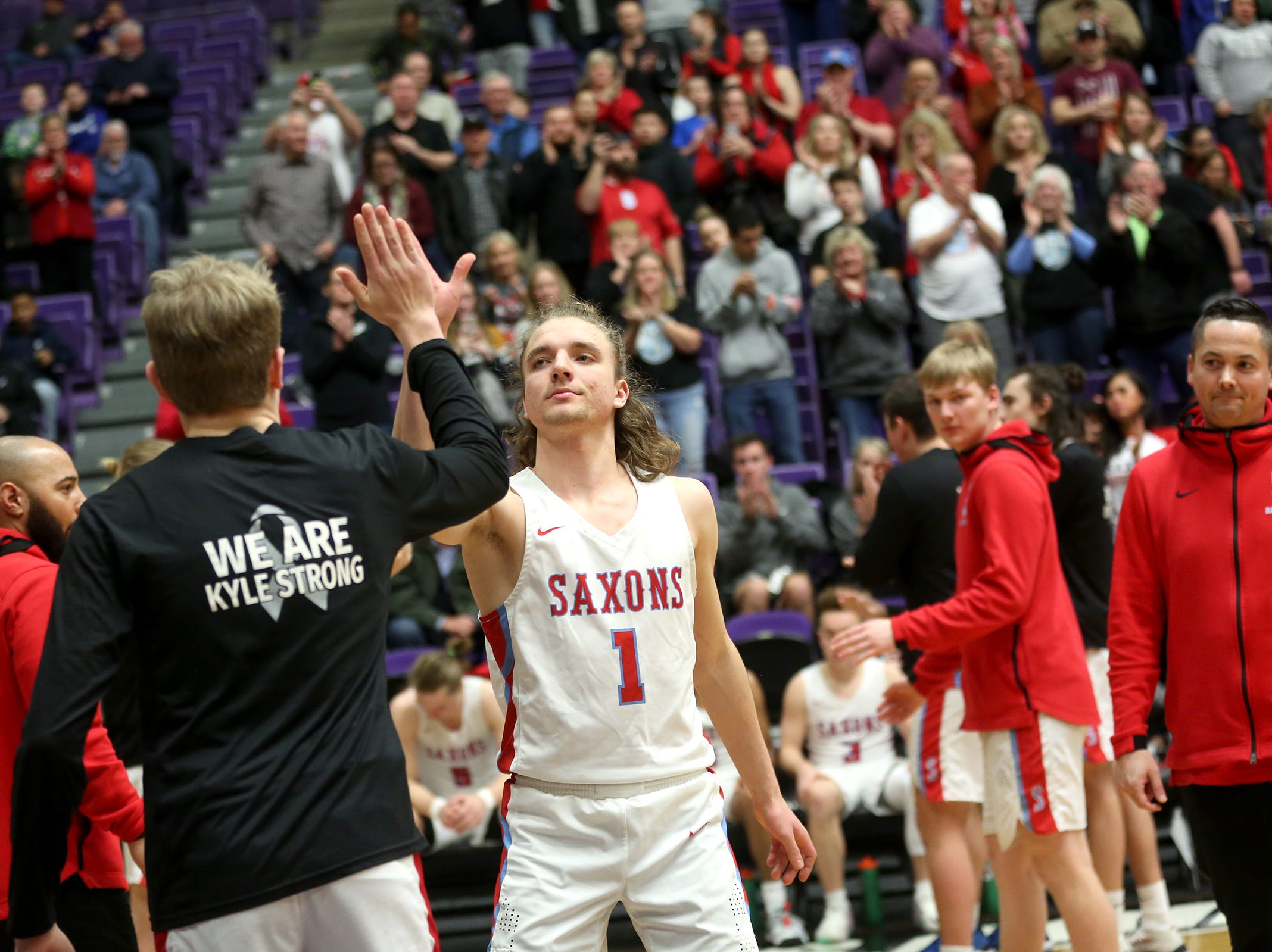 South Salem's Eric Lungu (1) is introduced in the starting lineup during the South Salem vs. Jefferson boys basketball OSAA 6A semifinal game at Chiles Center in Portland on Friday, March 8, 2019.