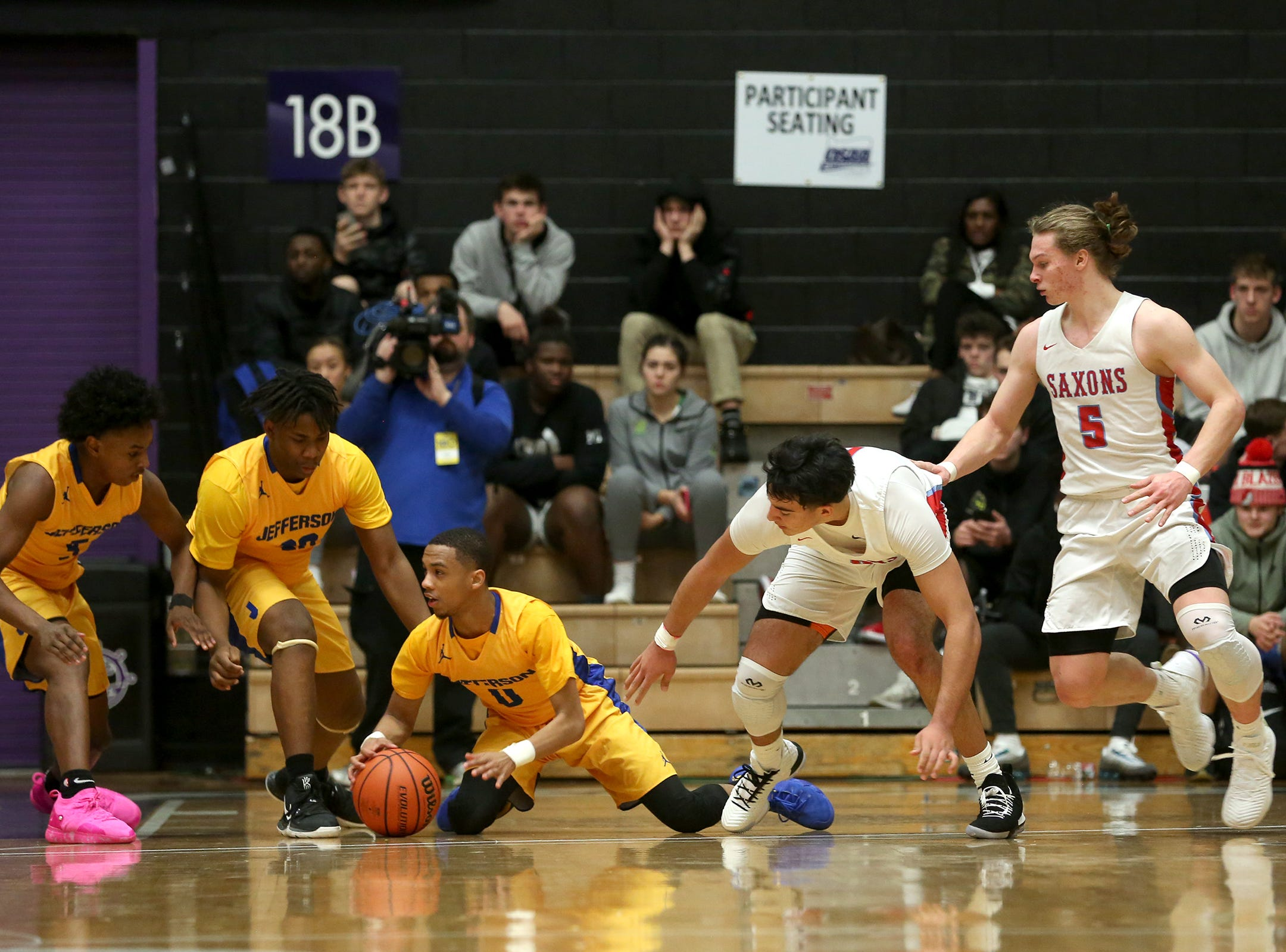 Jefferson and South Salem players struggle for the ball during the South Salem vs. Jefferson boys basketball OSAA 6A semifinal game at Chiles Center in Portland on Friday, March 8, 2019.