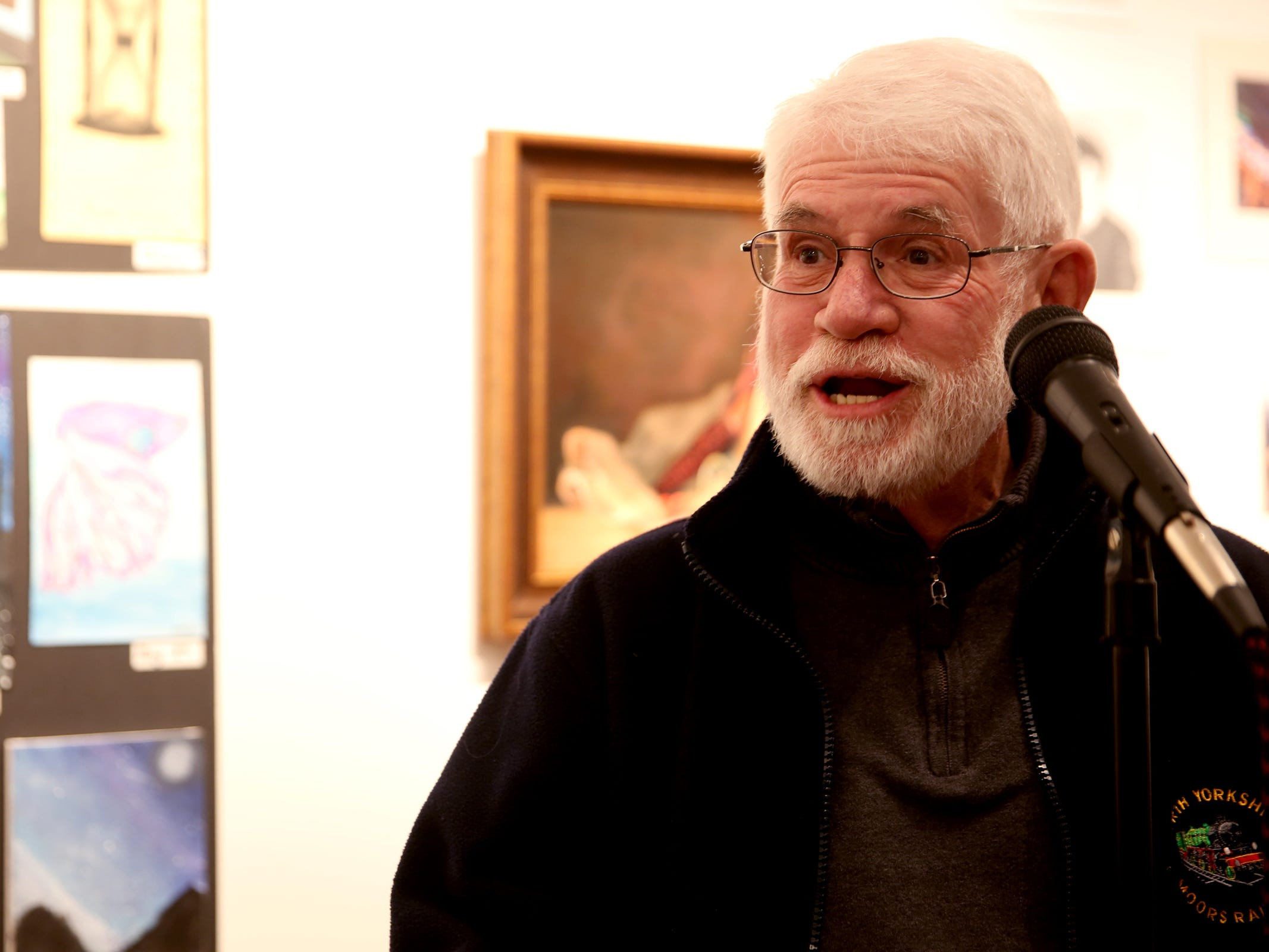 Mayor Chuck Bennett presents an award during the 10th annual Young Artists' Showcase at the Bush Barn Art Center in Salem on March 9, 2019. The exhibit features artwork by more than 400 students in Marion, Polk and Yamhill counties and runs through April 20.