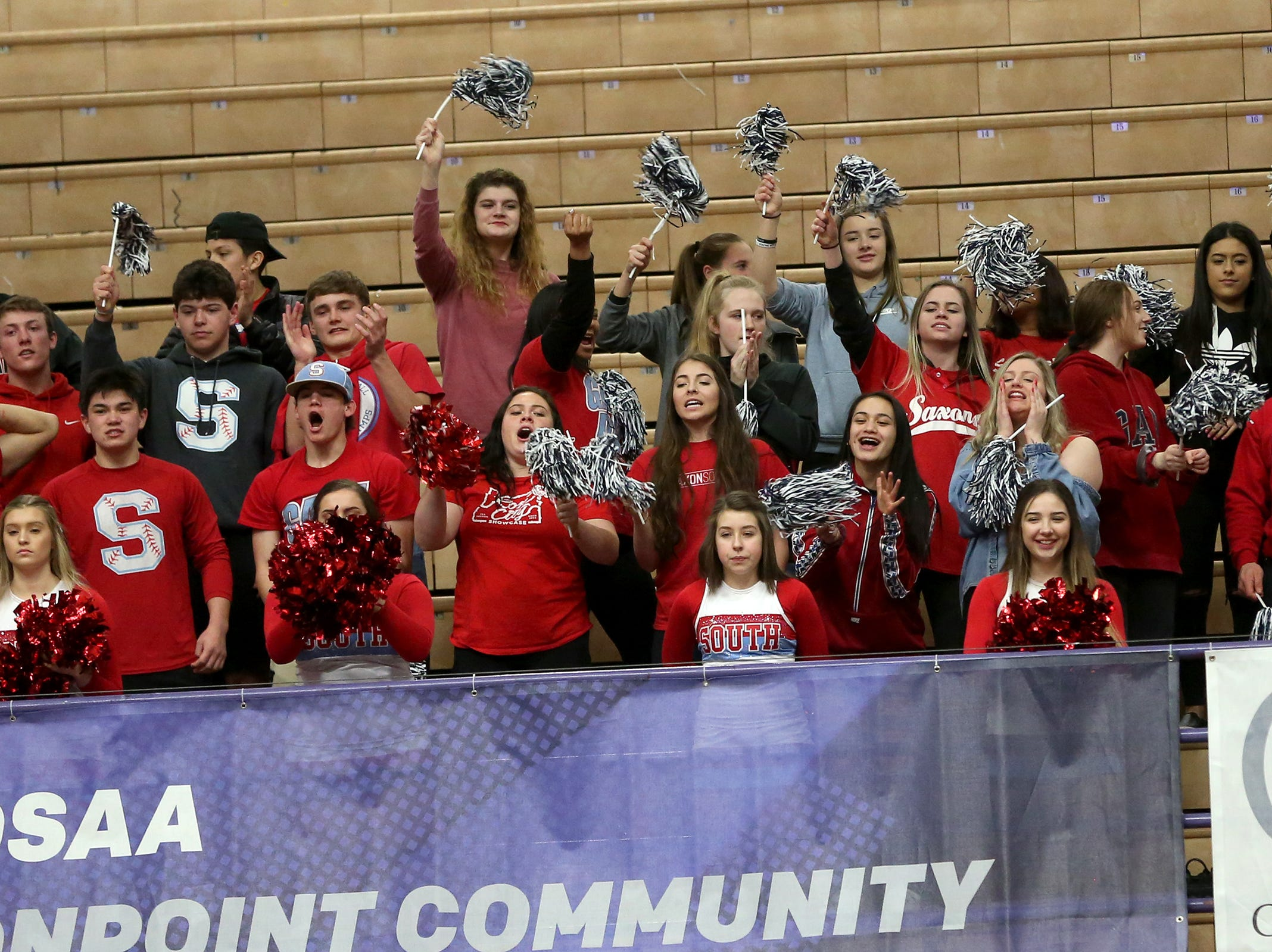 South Salem students cheer on their team during the South Salem vs. Jefferson boys basketball OSAA 6A semifinal game at Chiles Center in Portland on Friday, March 8, 2019.