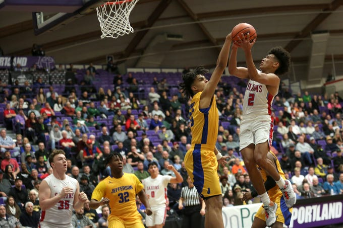 South Salem's Jaden Nielsen-Skinner (2) goes up for a shot during the South Salem vs. Jefferson boys basketball OSAA 6A semifinal game at Chiles Center in Portland on Friday, March 8, 2019.