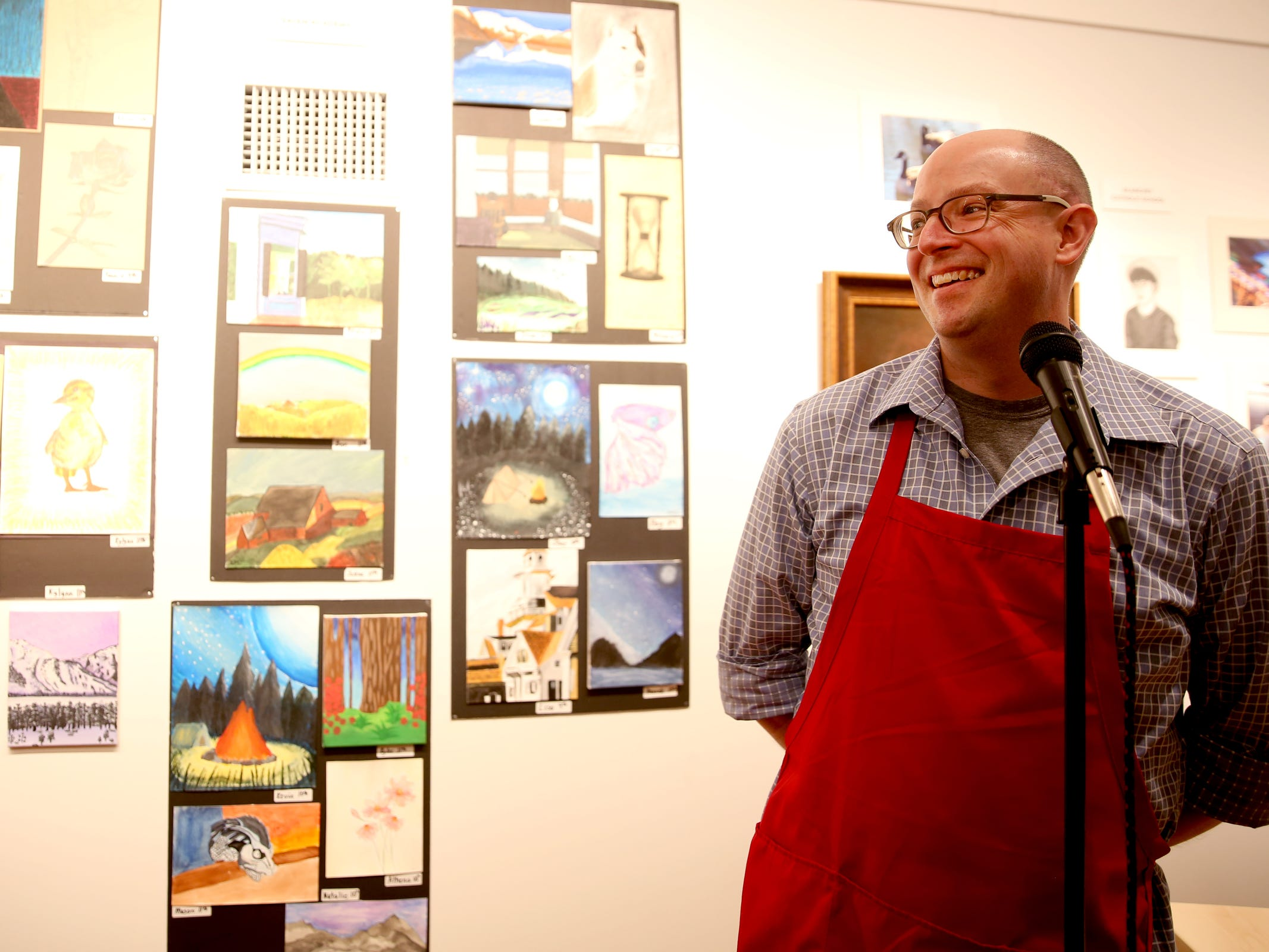 David Wilson, Gallery Director for the Salem Art Association, emcees the awards reception for the 10th annual Young Artists' Showcase at the Bush Barn Art Center in Salem on March 9, 2019. The exhibit features artwork by more than 400 students in Marion, Polk and Yamhill counties and runs through April 20.