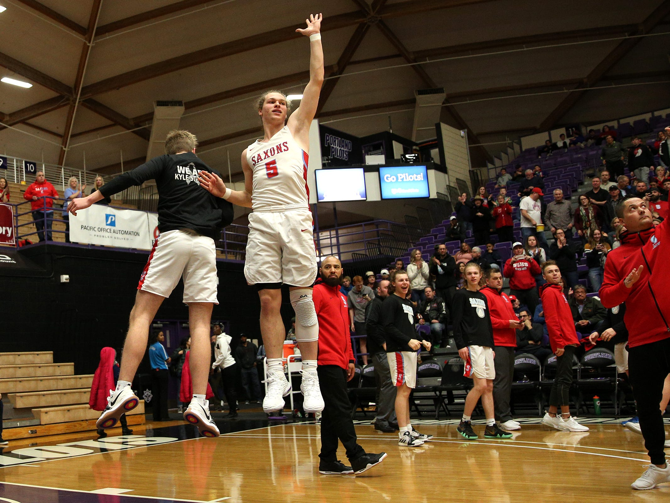 South Salem's Ryan Brown (5) jumps up as he is introduced in the starting lineup during the South Salem vs. Jefferson boys basketball OSAA 6A semifinal game at Chiles Center in Portland on Friday, March 8, 2019.