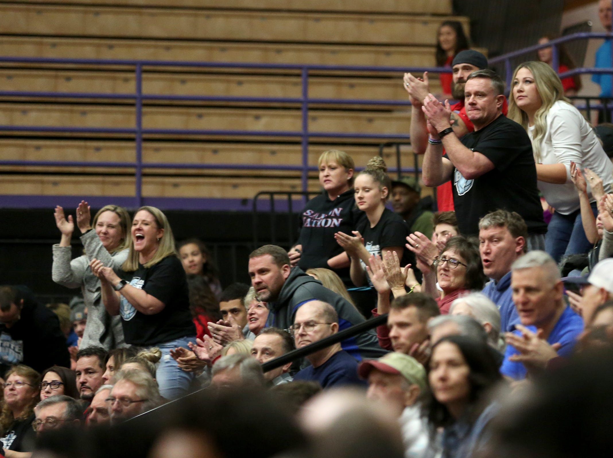 South Salem fans cheer on their team during the South Salem vs. Jefferson boys basketball OSAA 6A semifinal game at Chiles Center in Portland on Friday, March 8, 2019.