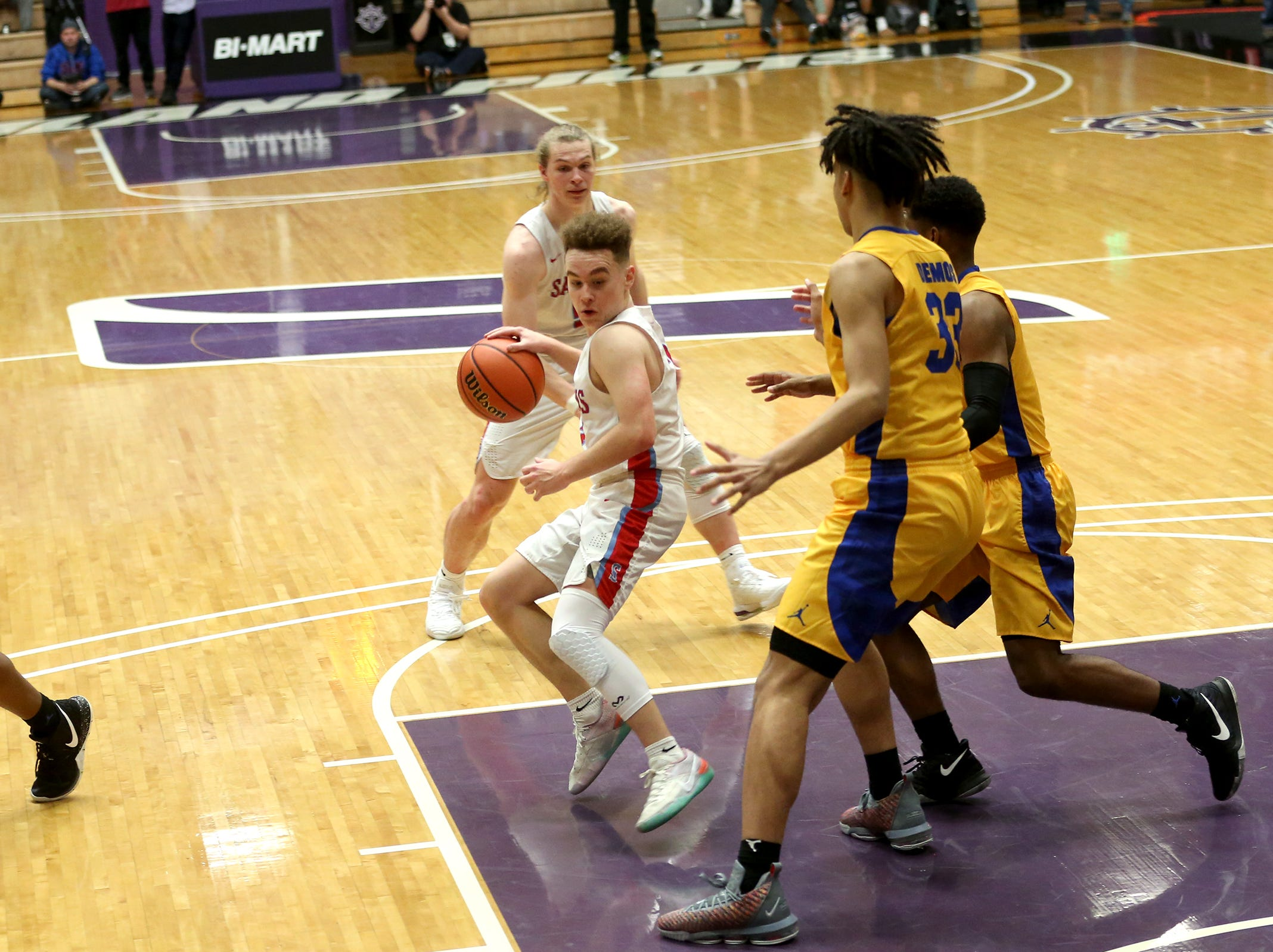 South Salem's Trey Galbraith (3) tries to get around Jefferson defenders during the South Salem vs. Jefferson boys basketball OSAA 6A semifinal game at Chiles Center in Portland on Friday, March 8, 2019.
