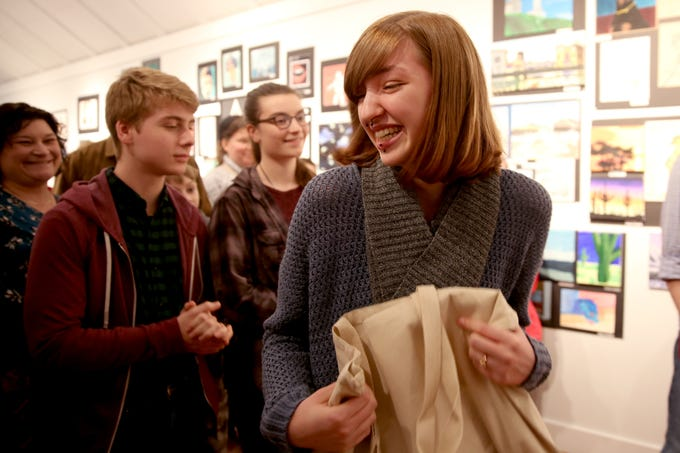 Iris Martin, from South Salem High School, accepts the Mayor's Choice Award during the 10th annual Young Artists' Showcase at the Bush Barn Art Center in Salem on March 9, 2019. The exhibit features artwork by more than 400 students in Marion, Polk and Yamhill counties and runs through April 20.