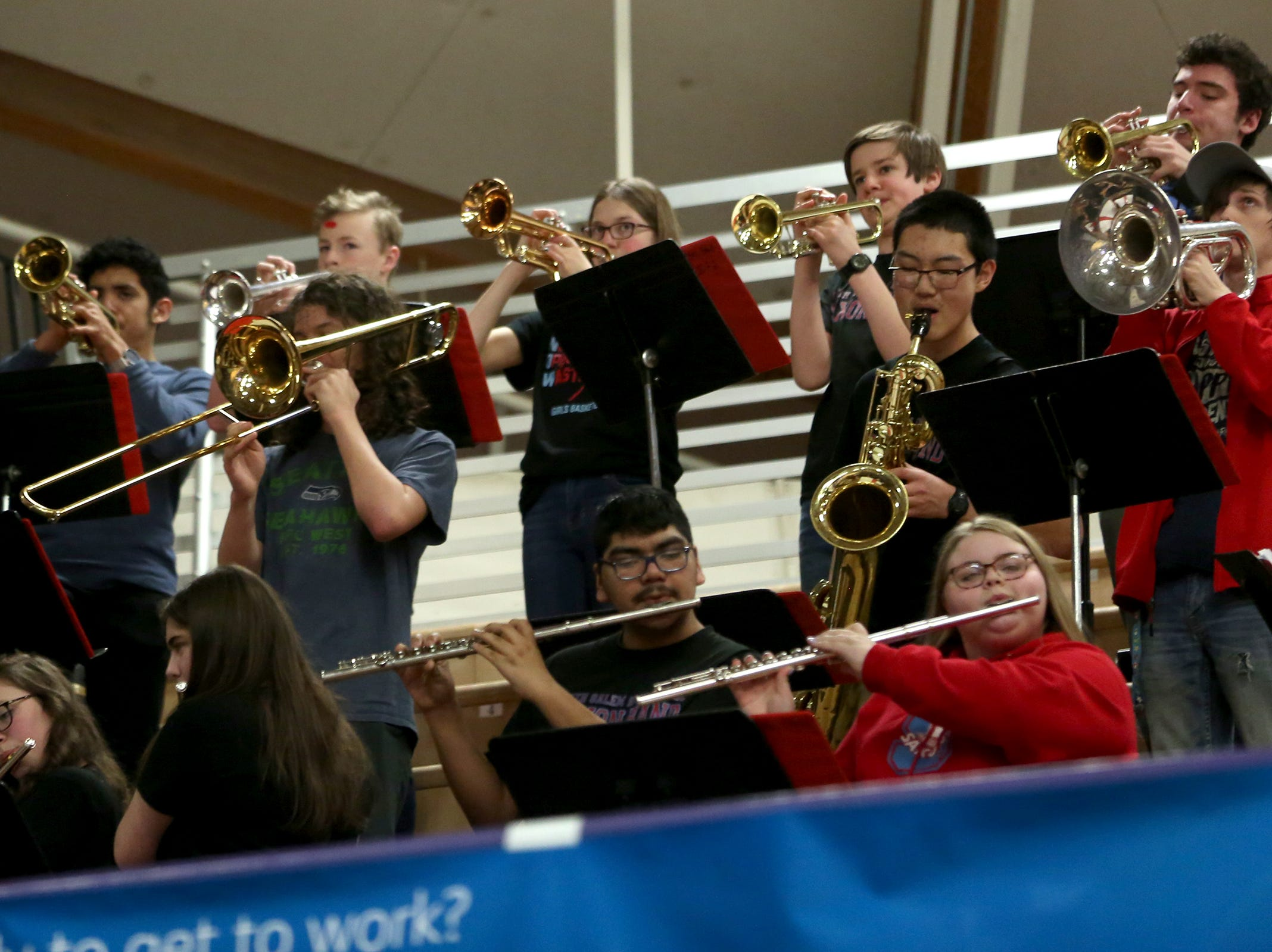 South Salem's band plays during the South Salem vs. Jefferson boys basketball OSAA 6A semifinal game at Chiles Center in Portland on Friday, March 8, 2019.