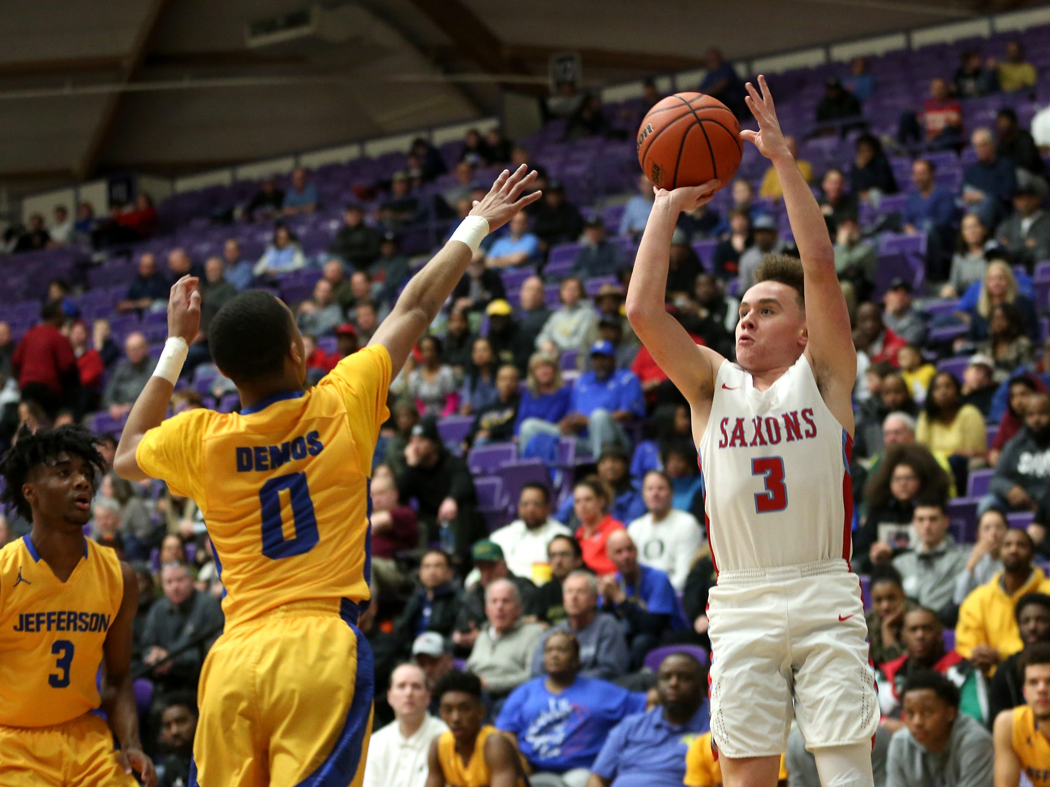 South Salem's Trey Galbraith (3) protects the ball during the South Salem vs. Jefferson boys basketball OSAA 6A semifinal game at Chiles Center in Portland on Friday, March 8, 2019.