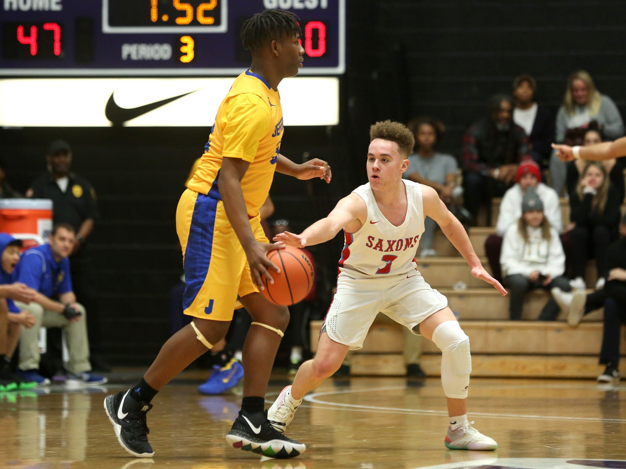 South Salem's Trey Galbraith (3) guards during the South Salem vs. Jefferson boys basketball OSAA 6A semifinal game at Chiles Center in Portland on Friday, March 8, 2019.