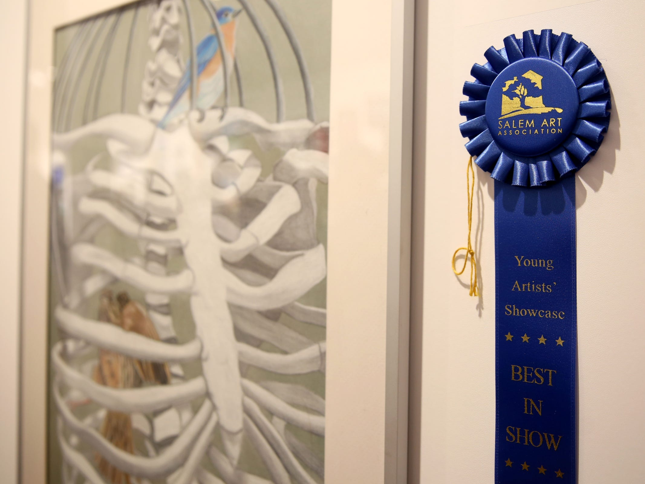 An artwork by Elizabeth Orlov, a Sprague High School senior, is awarded Best in Show during the 10th annual Young Artists' Showcase at the Bush Barn Art Center in Salem on March 9, 2019. The exhibit features artwork by more than 400 students in Marion, Polk and Yamhill counties and runs through April 20.