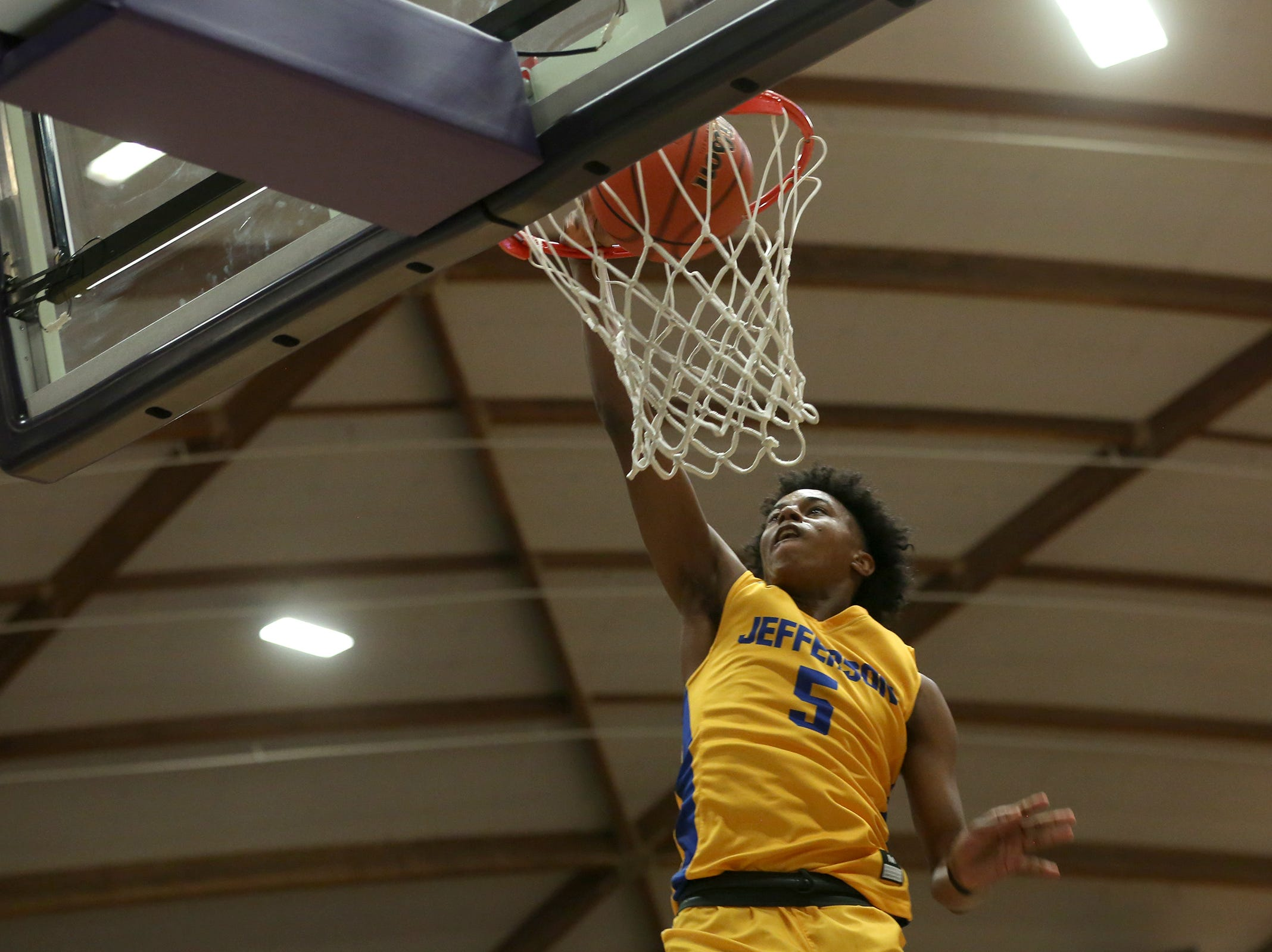 South Salem's Keylin Vance (5) gets a dunk in during the South Salem vs. Jefferson boys basketball OSAA 6A semifinal game at Chiles Center in Portland on Friday, March 8, 2019.