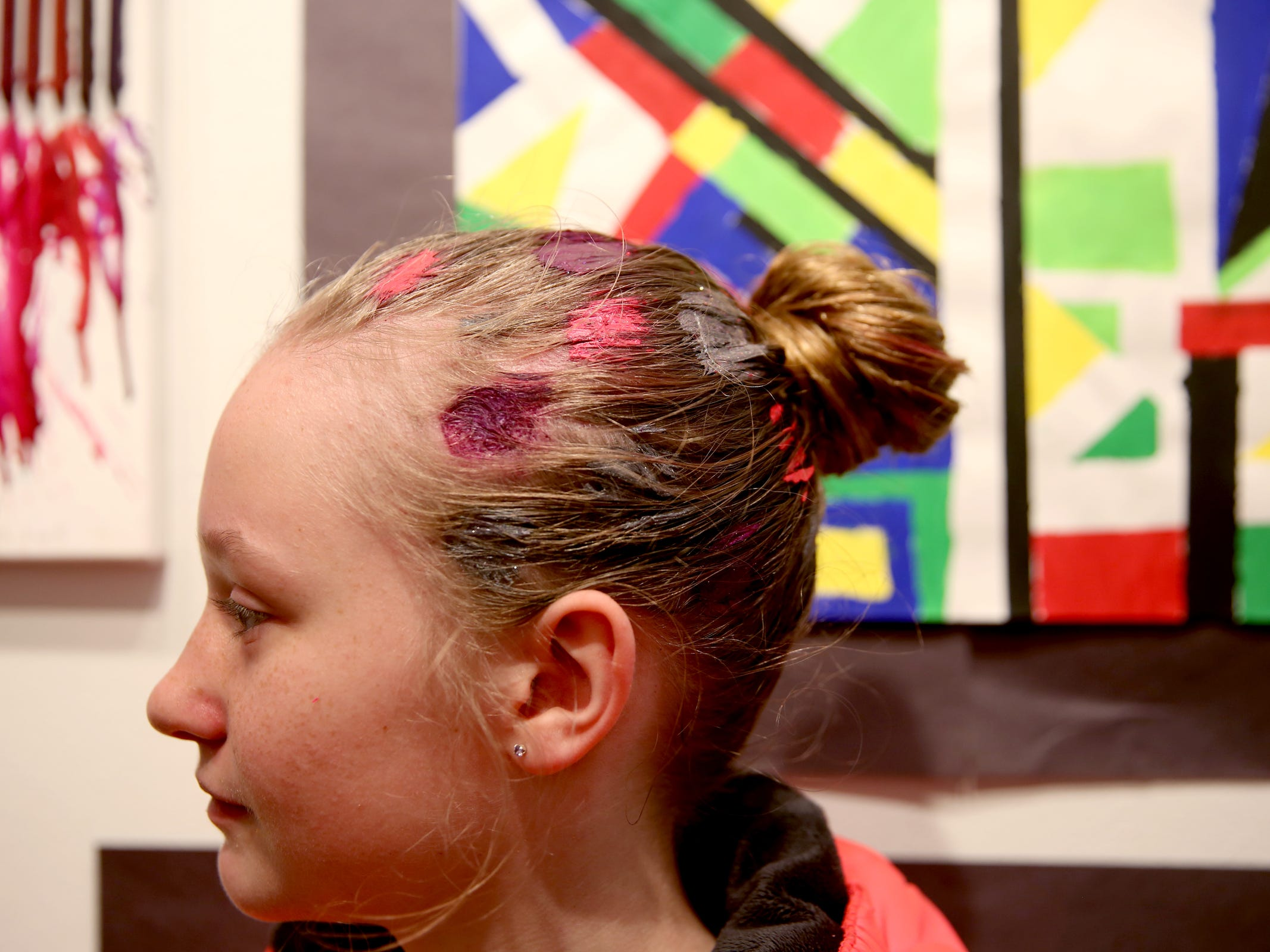 Liberty Skyler, a Mid-Valley Christian Academy fourth-grader, has painted polka-dots in her hair during the awards reception for the 10th annual Young Artists' Showcase at the Bush Barn Art Center in Salem on March 9, 2019. The exhibit features artwork by more than 400 students in Marion, Polk and Yamhill counties and runs through April 20.