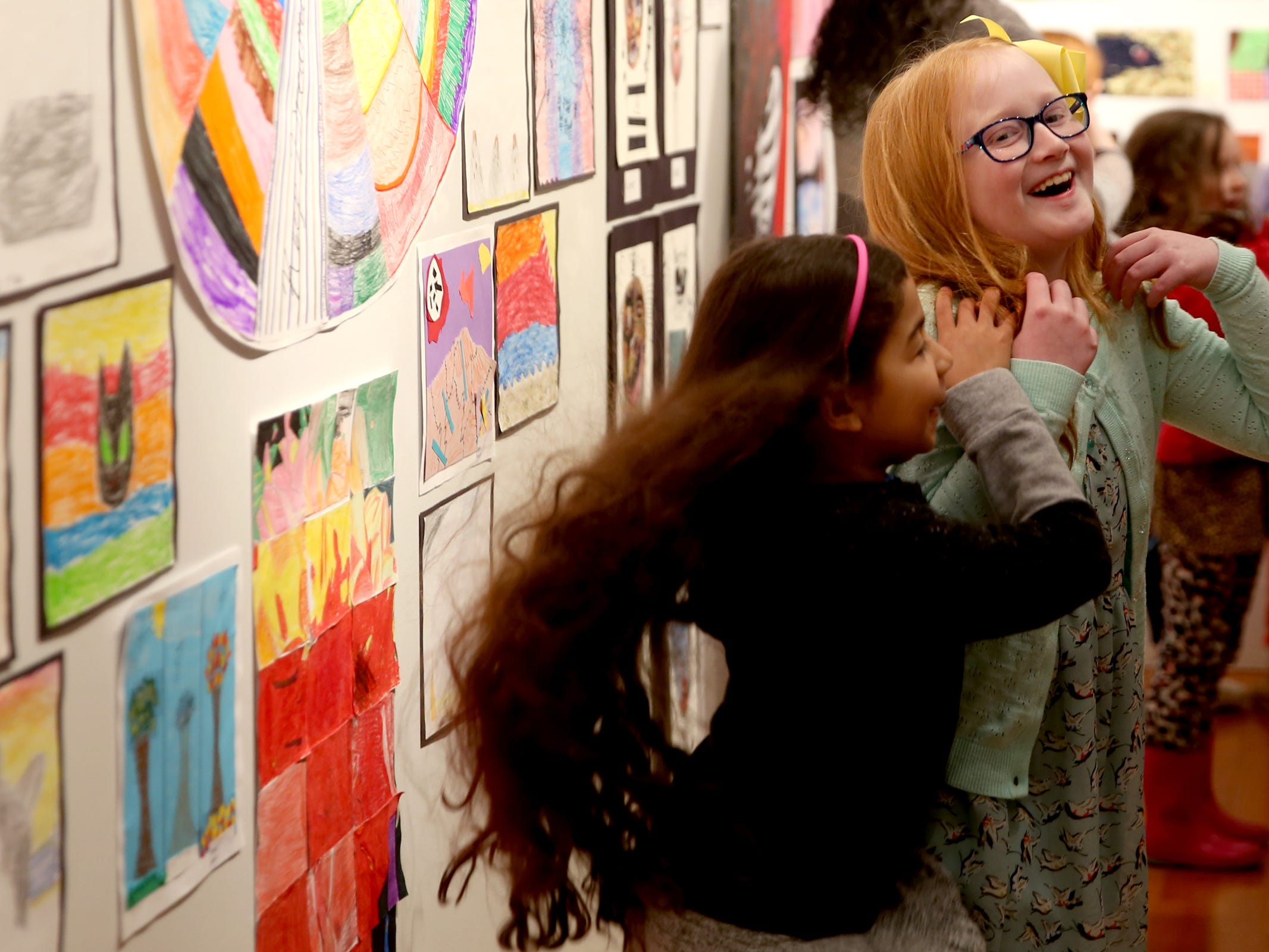 Olivia McCoy, left, and Grace Ball, both Sunshine Christian School second-graders, play during the awards reception for the 10th annual Young Artists' Showcase at the Bush Barn Art Center in Salem on March 9, 2019. The exhibit features artwork by more than 400 students in Marion, Polk and Yamhill counties and runs through April 20.