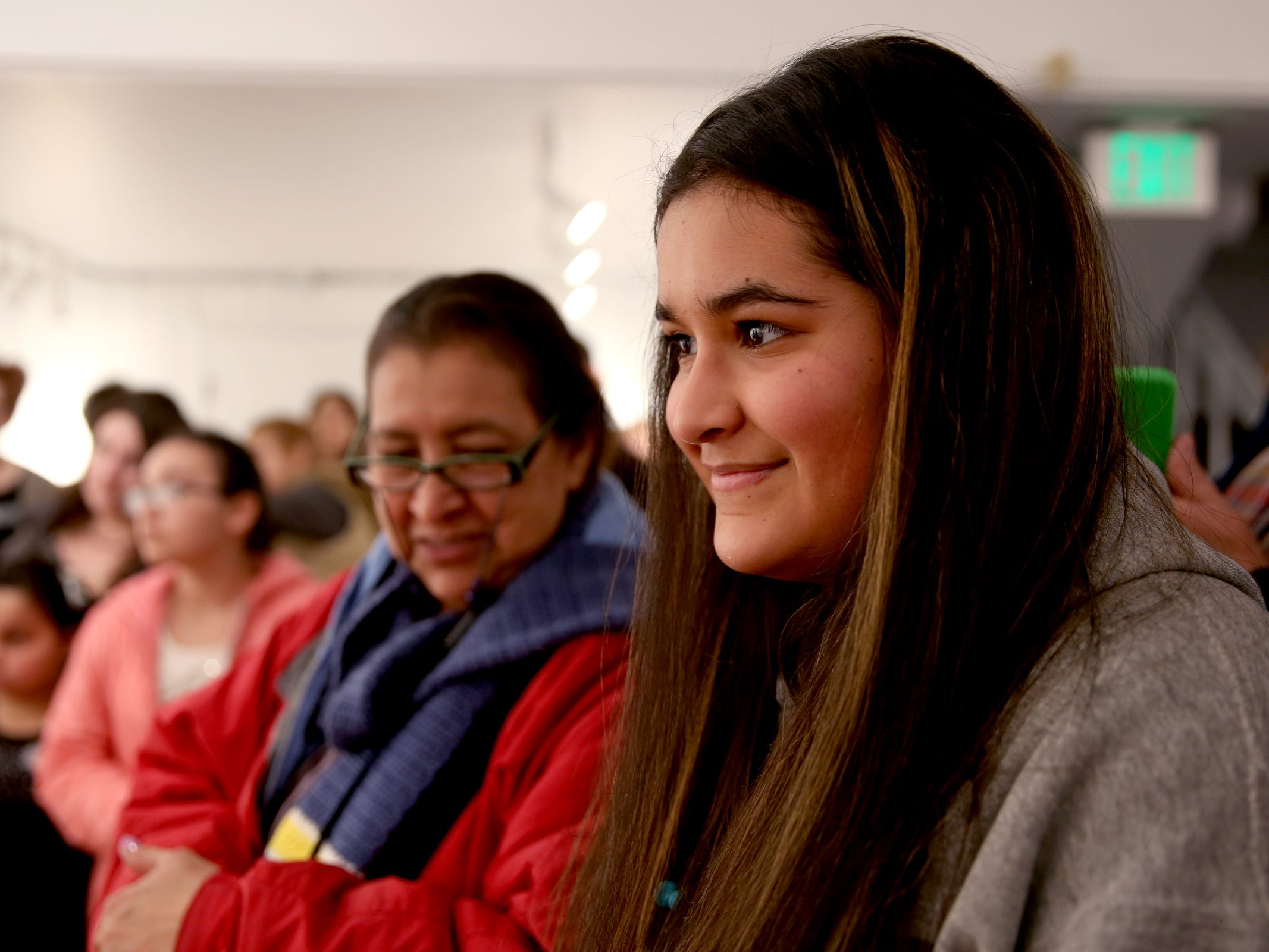 Selena Mendez, a Salem Academy junior, accepts the Poster Award, meaning her artwork will be featured on future promotional materials, during the 10th annual Young Artists' Showcase at the Bush Barn Art Center in Salem on March 9, 2019. The exhibit features artwork by more than 400 students in Marion, Polk and Yamhill counties and runs through April 20.