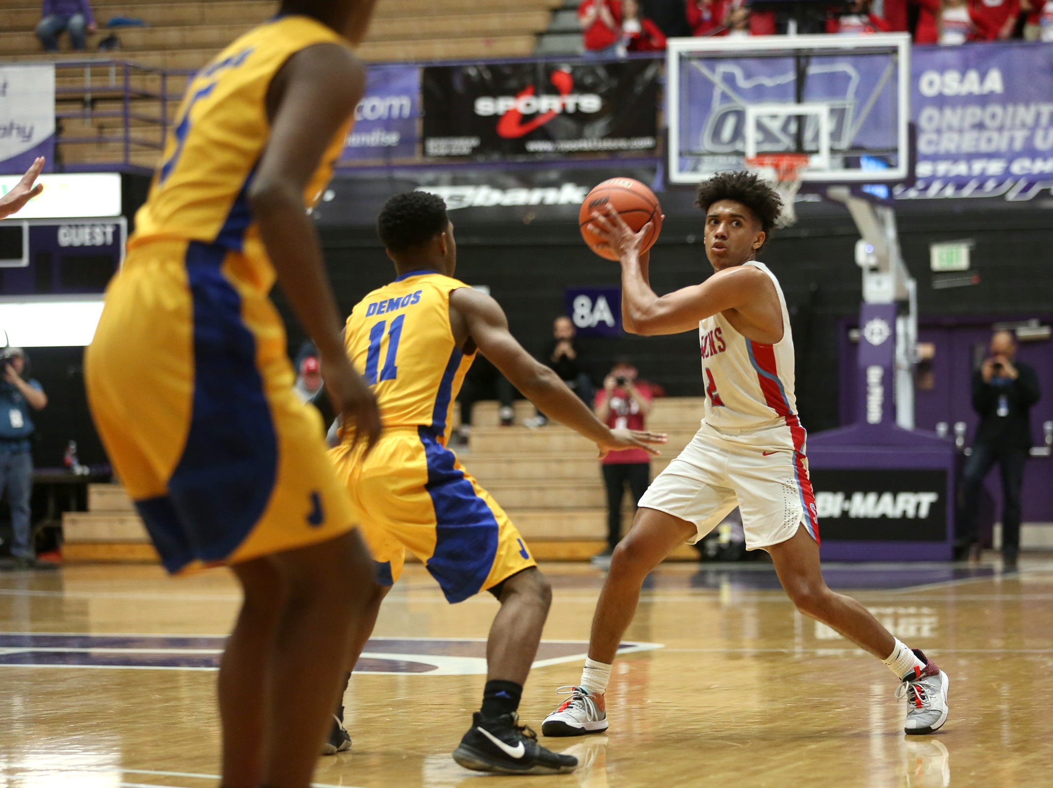 South Salem's Jaden Nielsen-Skinner (2) looks to make a pass during the South Salem vs. Jefferson boys basketball OSAA 6A semifinal game at Chiles Center in Portland on Friday, March 8, 2019.