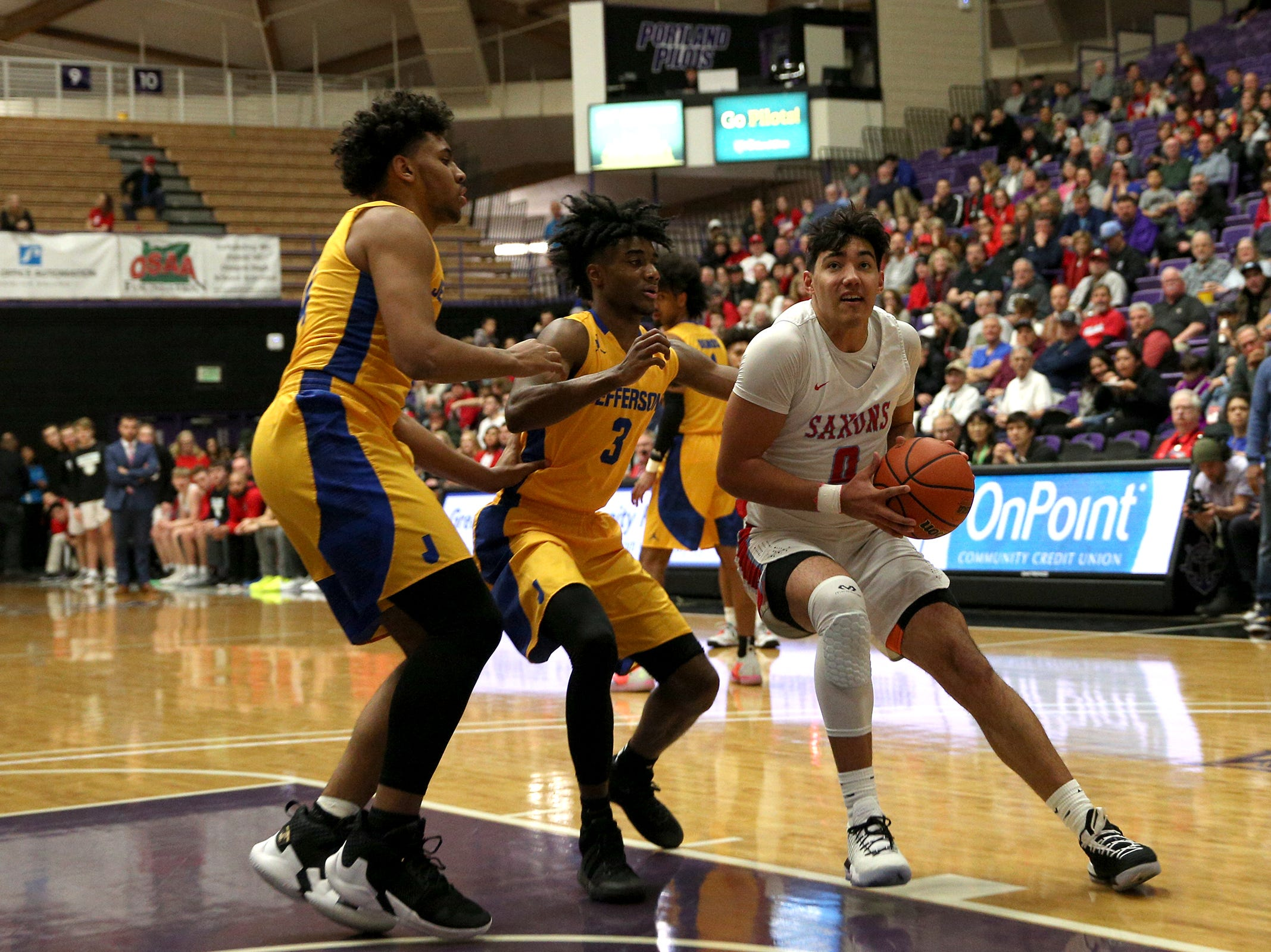 South Salem's Treyden Harris (0) makes his way into the paint during the South Salem vs. Jefferson boys basketball OSAA 6A semifinal game at Chiles Center in Portland on Friday, March 8, 2019.
