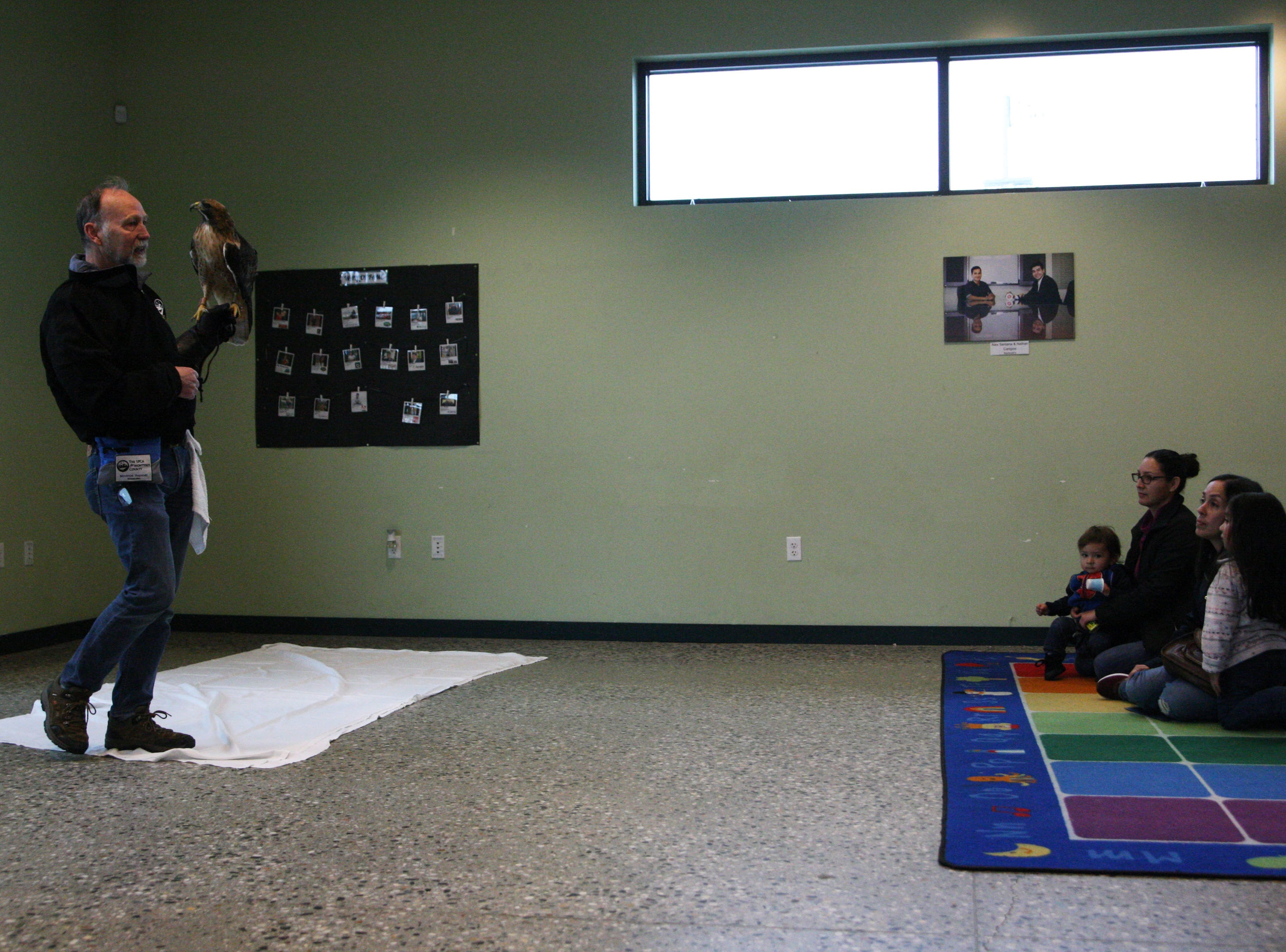 The SPCA brought a Red-tailed Hawk to Cesar Chavez Library Saturday, to an avid audience of 38.