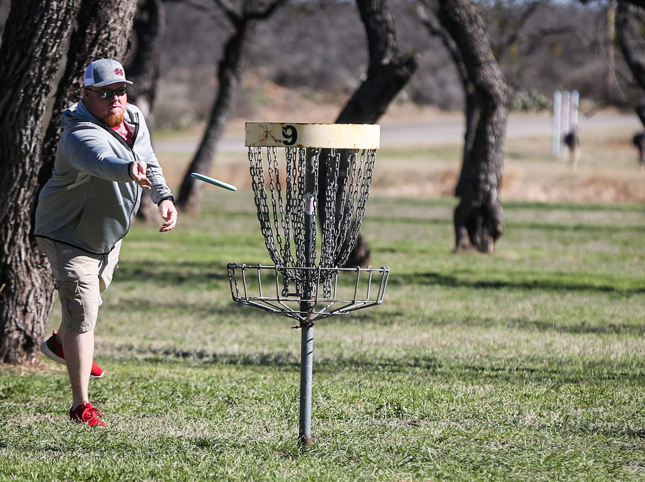 Peter Boen throws a disc during the Crush on the Concho tournament Saturday, March 9, 2019, at Middle Concho Park.