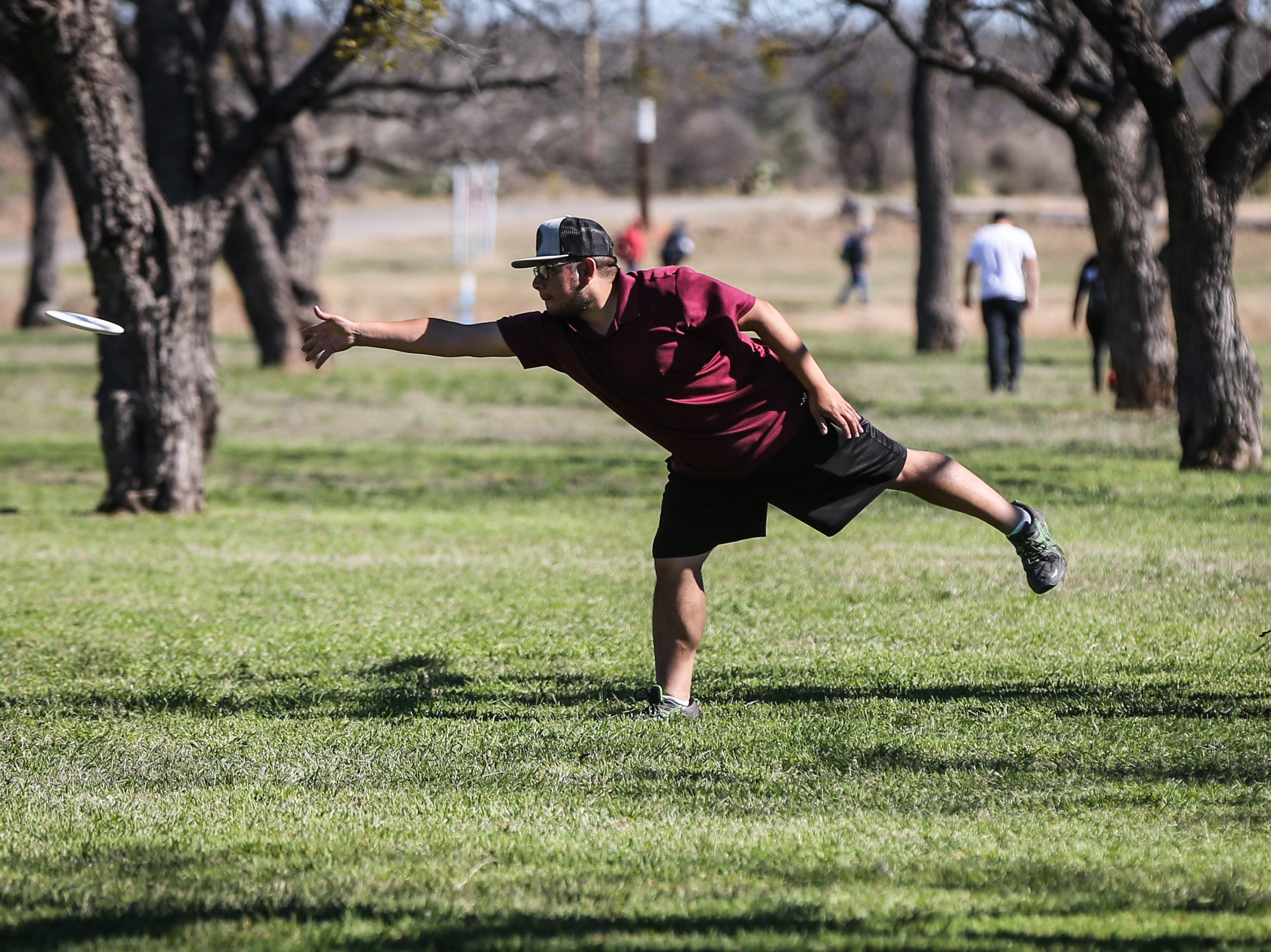Eric DeLeon Roy Martin throws a disc during the Crush on the Concho tournament Saturday, March 9, 2019, at Middle Concho Park.