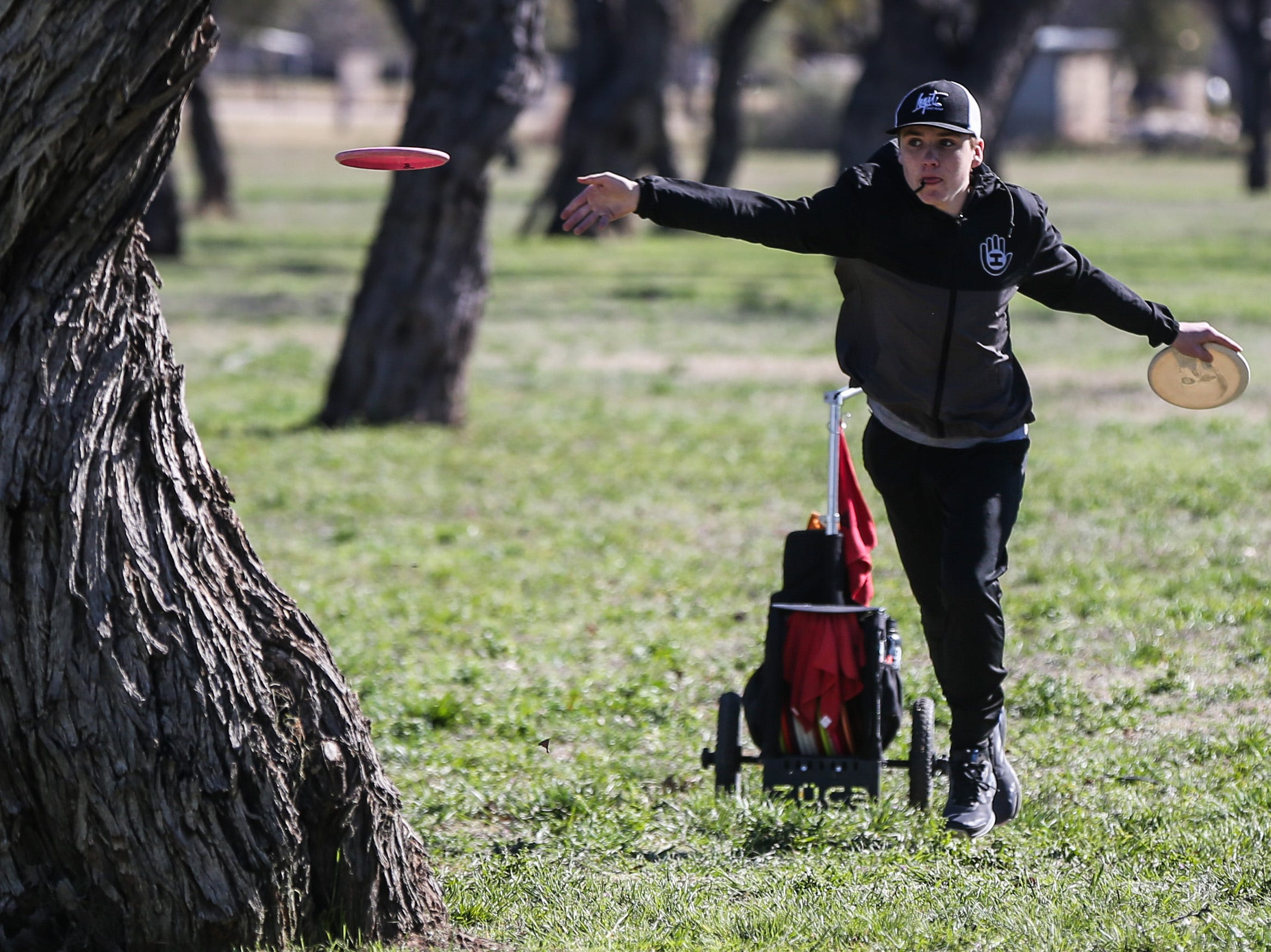 Bradin Balogh throws a disc during the Crush on the Concho tournament Saturday, March 9, 2019, at Middle Concho Park.