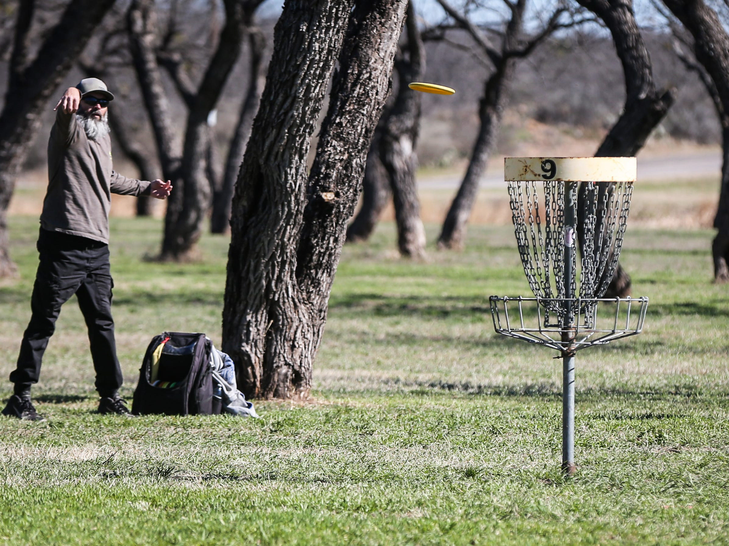 Dave Morgan throws a disc during the Crush on the Concho tournament Saturday, March 9, 2019, at Middle Concho Park.