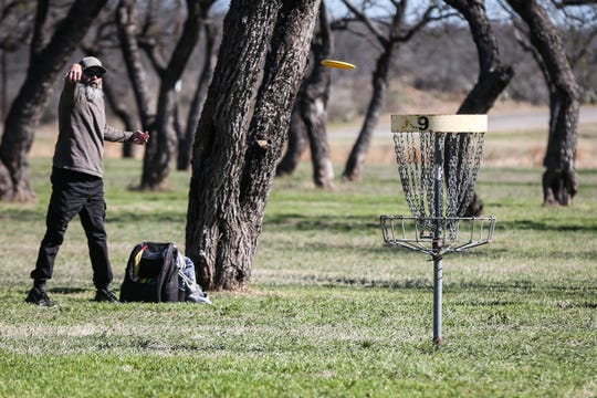 Dave Morgan throws a disc during the Crush on the Concho disc-golf tournament Saturday, March 9, 2019, at Middle Concho Park.