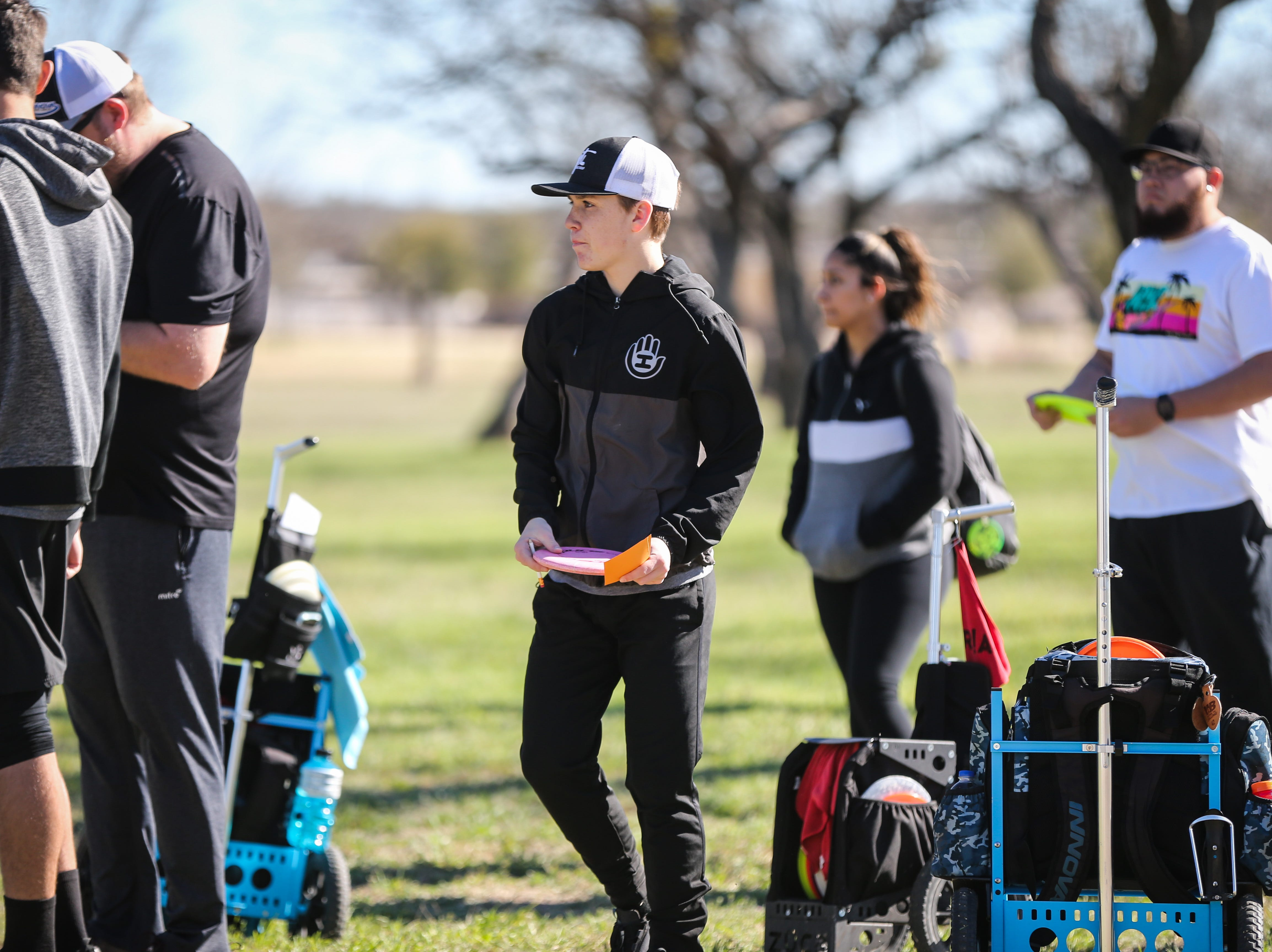 Participants get ready for the next hole during the Crush on the Concho tournament Saturday, March 9, 2019, at Middle Concho Park.