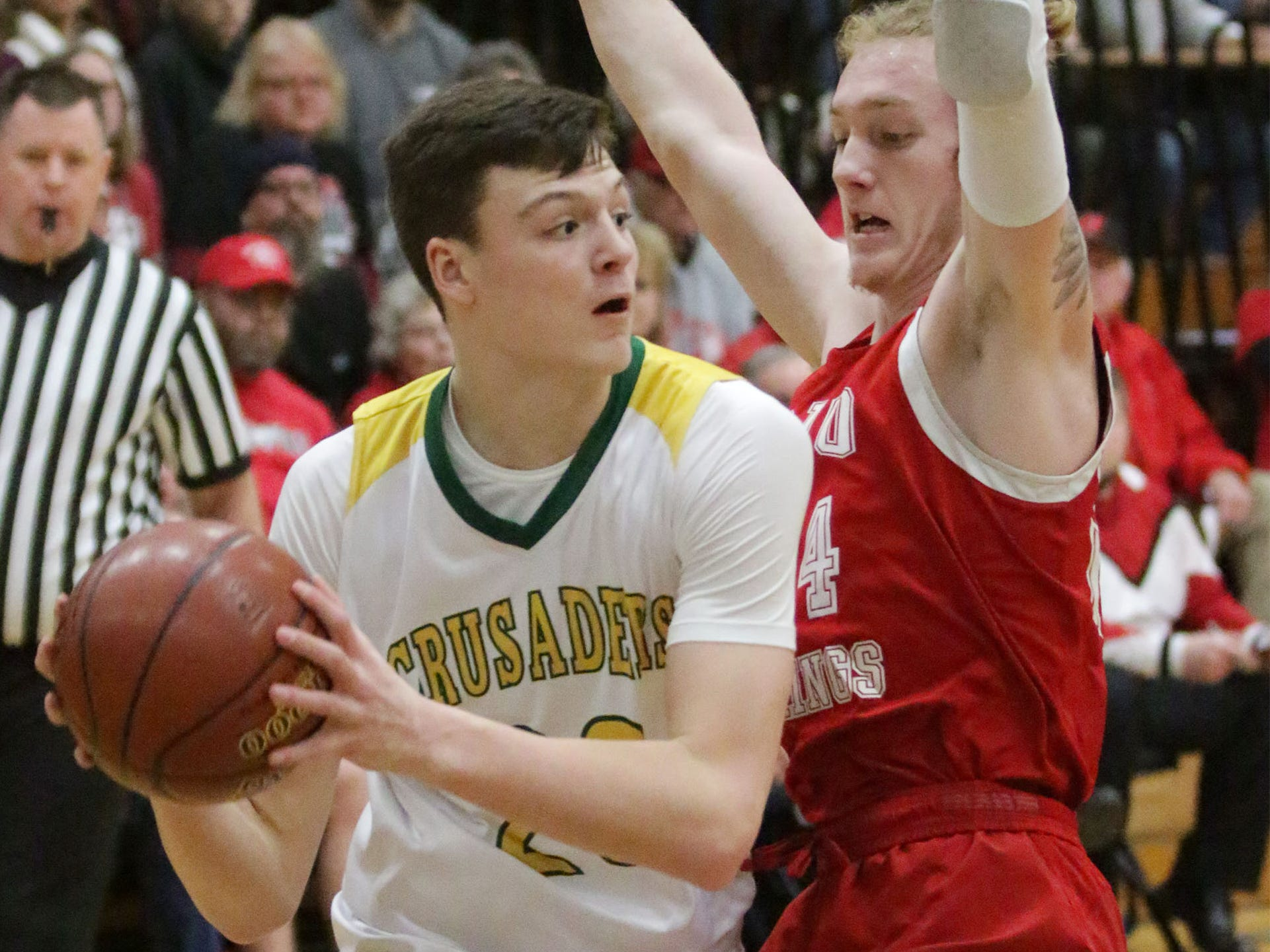 Sheboygan Lutheran's Jacob Ognacevic (23) looks to pass the ball around Rio's Nathan Rippl (24), Saturday, March 9, 2019, in West Bend, Wis.