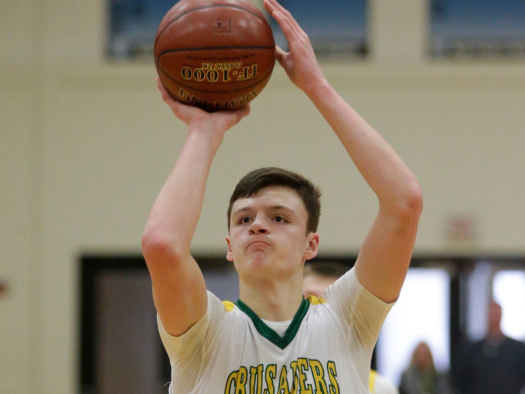 Sheboygan Lutheran's Jacob Ognacevic (23) aims free throw against Rio, Saturday, March 9, 2019, in West Bend, Wis.