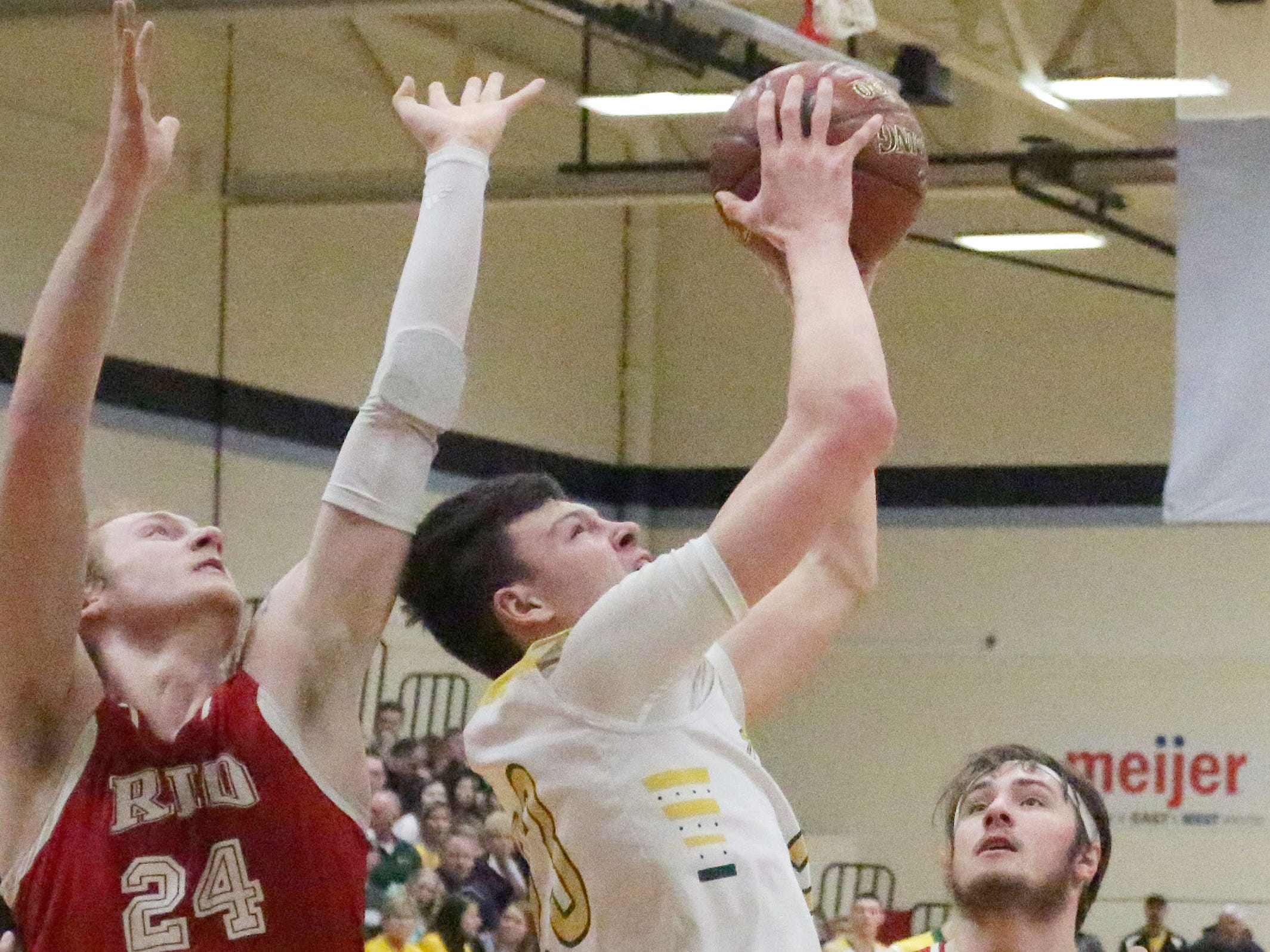 Sheboygan Lutheran's Jacob Ognacevic (23, center) rebounds the ball against Rio, Saturday, March 9, 2019, in West Bend, Wis.