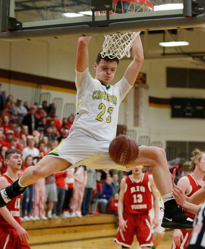 Sheboygan Lutheran's Jacob Ognacevic (23) jams a shot against Rio, Saturday, March 9, 2019, in West Bend, Wis.