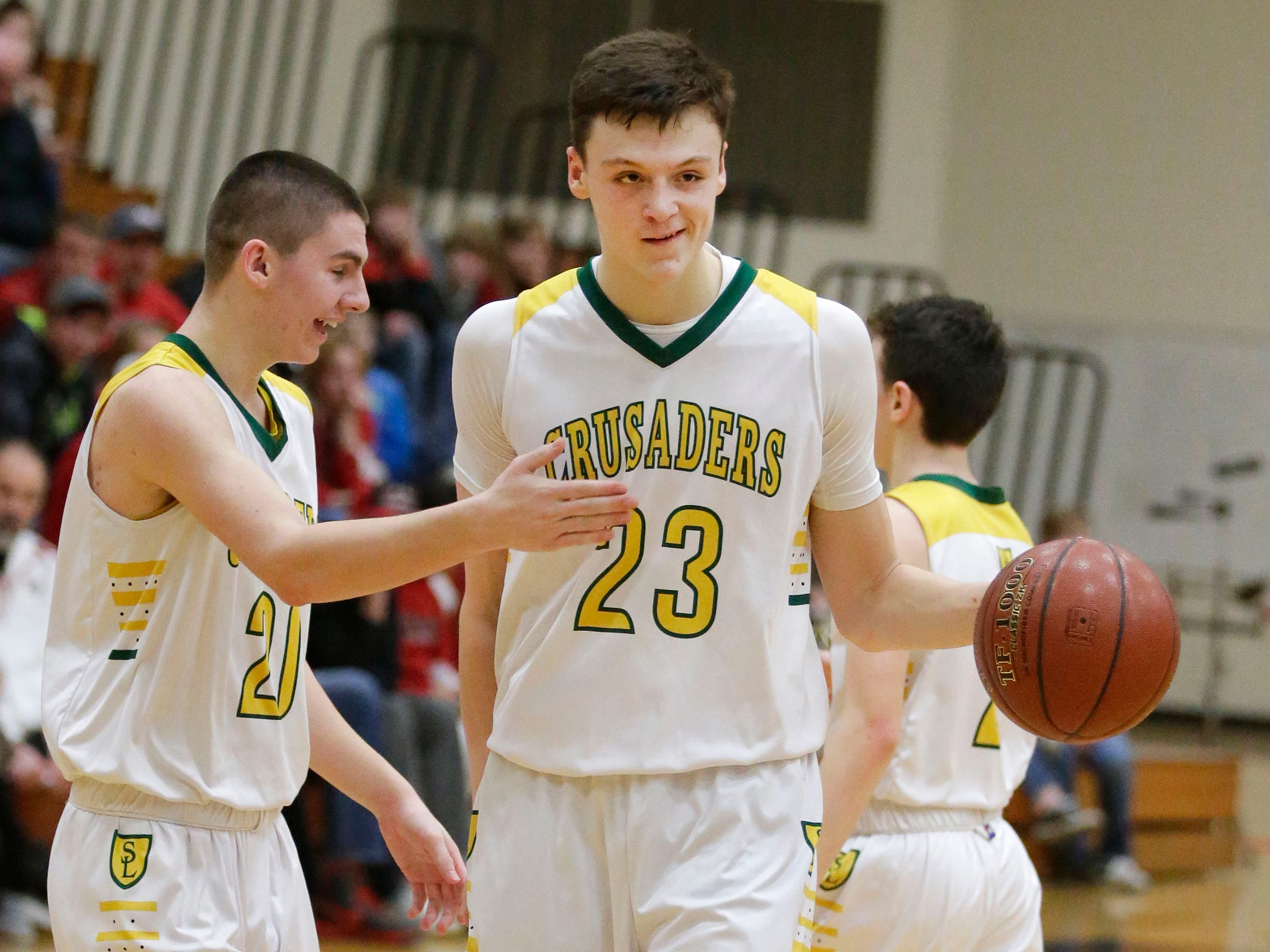 Sheboygan Lutheran's Jacob Ognacevic (23) reacts with team mate Jonah Jurss (21) following their 83-69 win over Rio, Saturday, March 9, 2019, in West Bend, Wis.