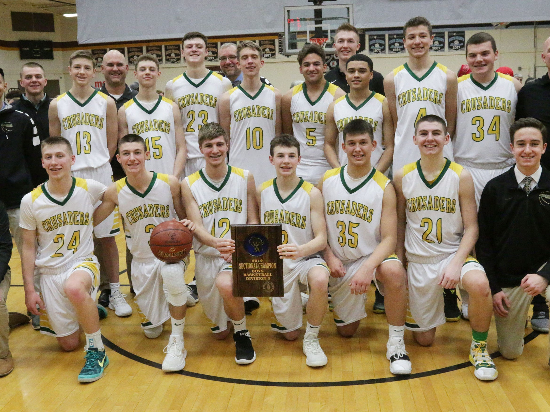 Sheboygan Lutheran's team poses after their 83-69 win over Rio in the WIAA Div. 5 sectional, Saturday, March 9, 2019, in Sheboygan, Wis.