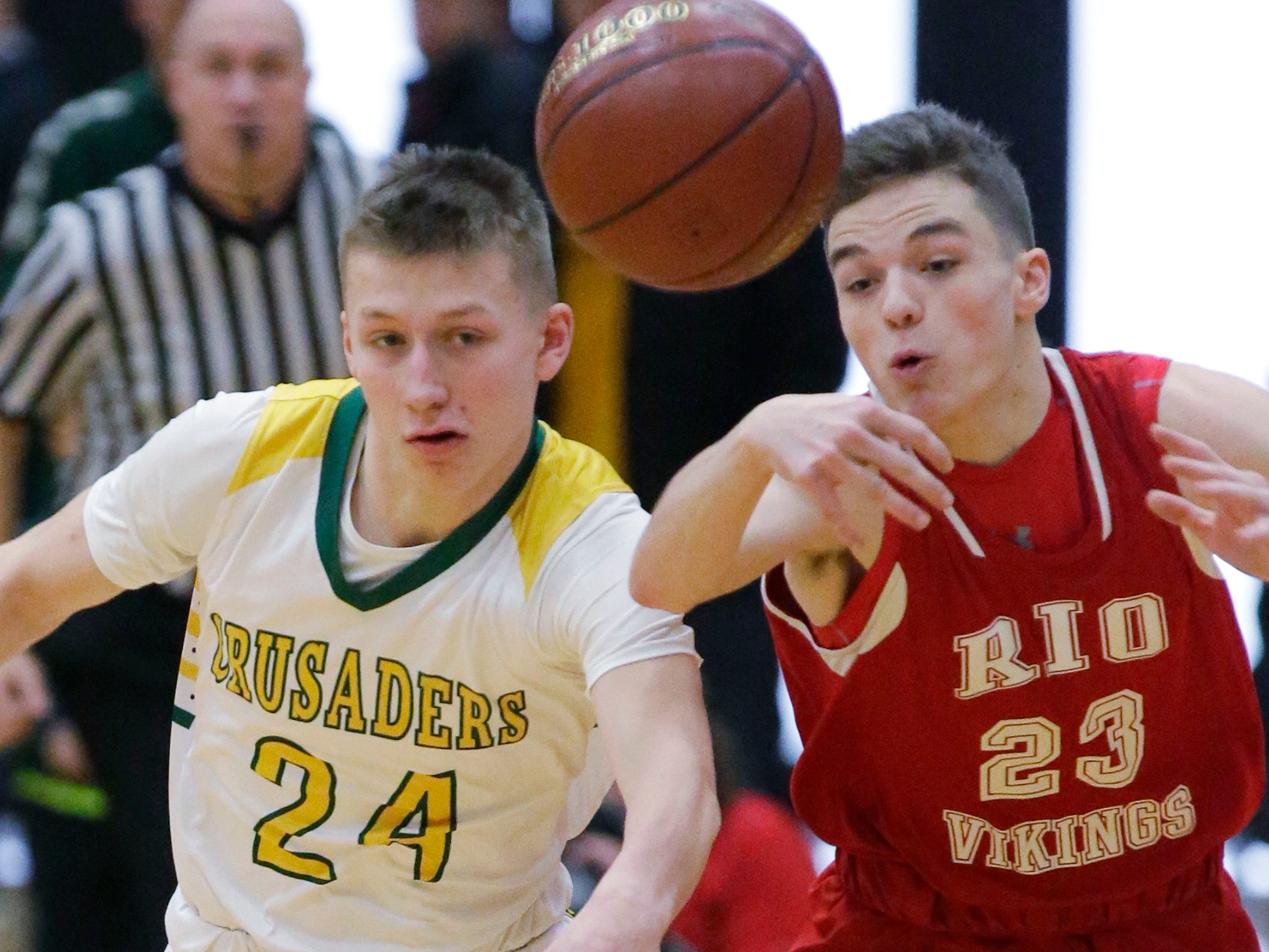 Sheboygan Lutheran's Casey Verhagen (24) chases the ball by Rio's Carson Richardson (23), during WIAA Div. 5 sectional action, Saturday, March 9, 2019, in West Bend, Wis.
