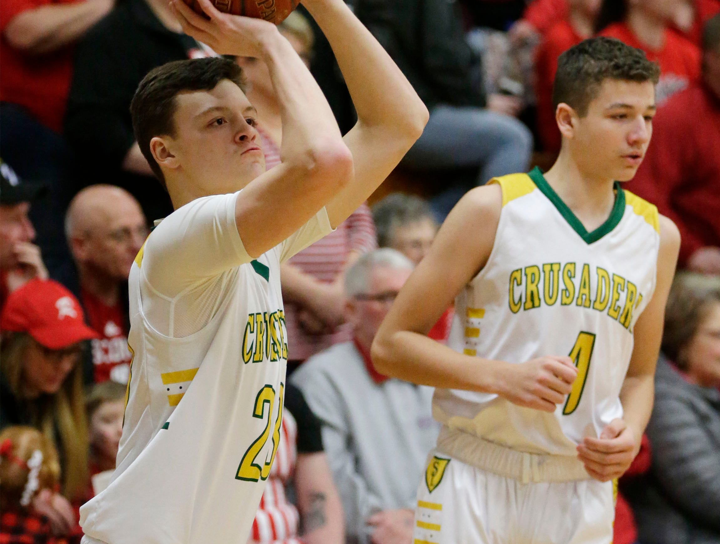 Sheboygan Lutheran's Jacob Ognacevic (23) aims a practice shot before the game with Rio, Saturday, March 9, 2019, in West Bend, Wis.