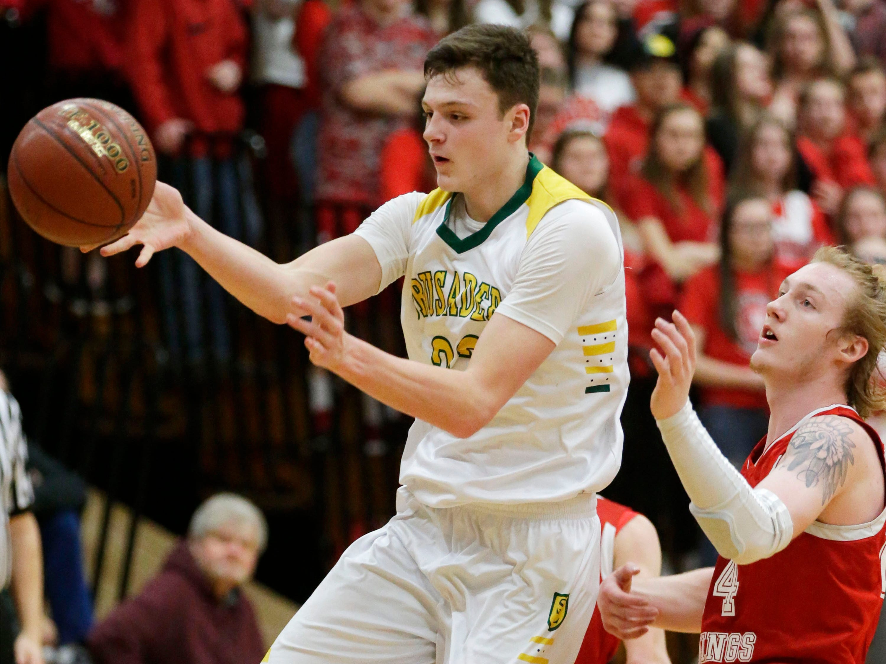 Sheboygan Lutheran's Jacob Ognacevic (23, left) passes the ball by Rio's Nathan Rippl (24), Saturday, March 9, 2019, in West Bend, Wis.