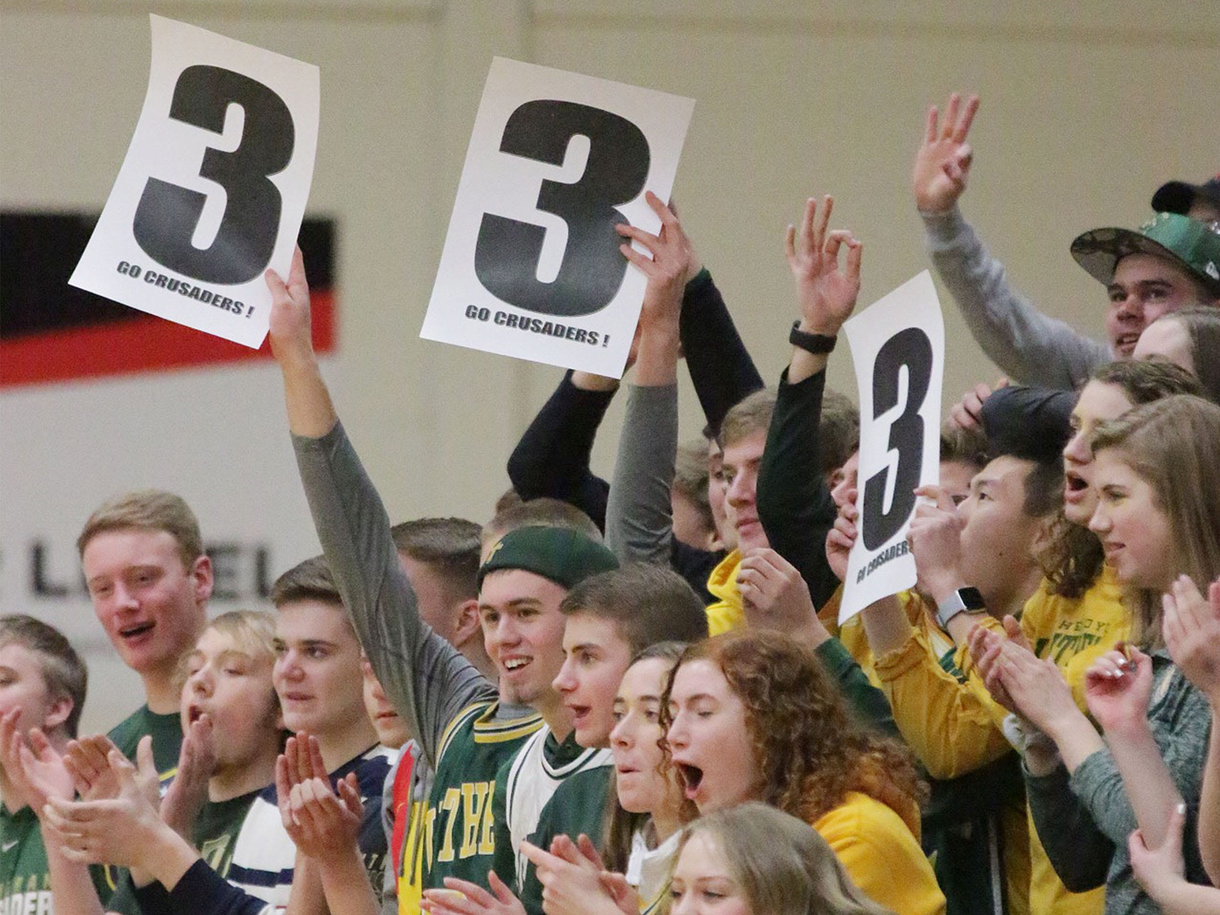 Sheboygan Lutheran fans celebrate a 3-point shot during action with Rio, Saturday, March 9, 2019, in Sheboygan, Wis.